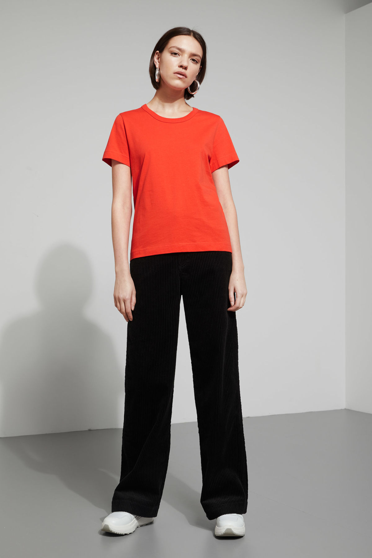 Model side image of Weekday kate t-shirt in orange