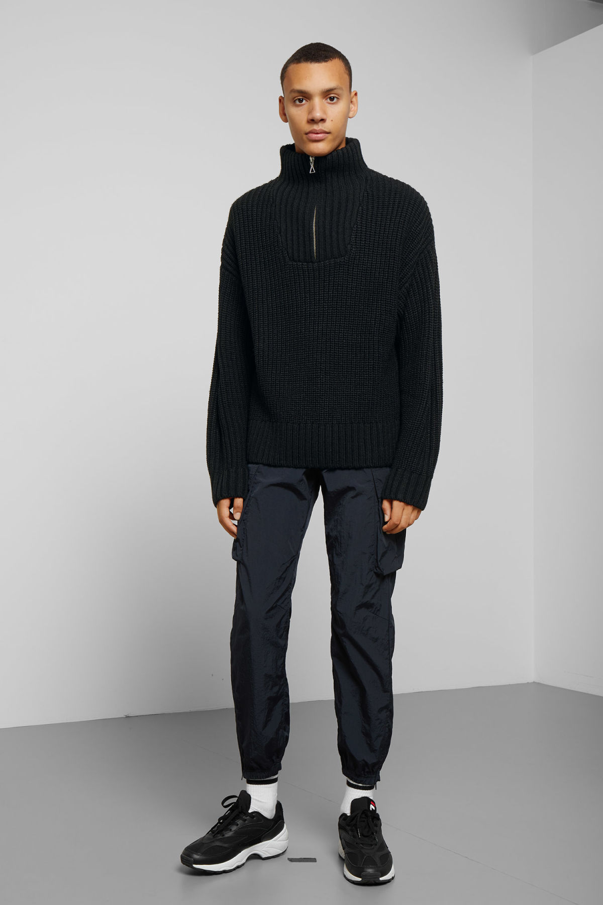 Model side image of Weekday arnold sweater in black