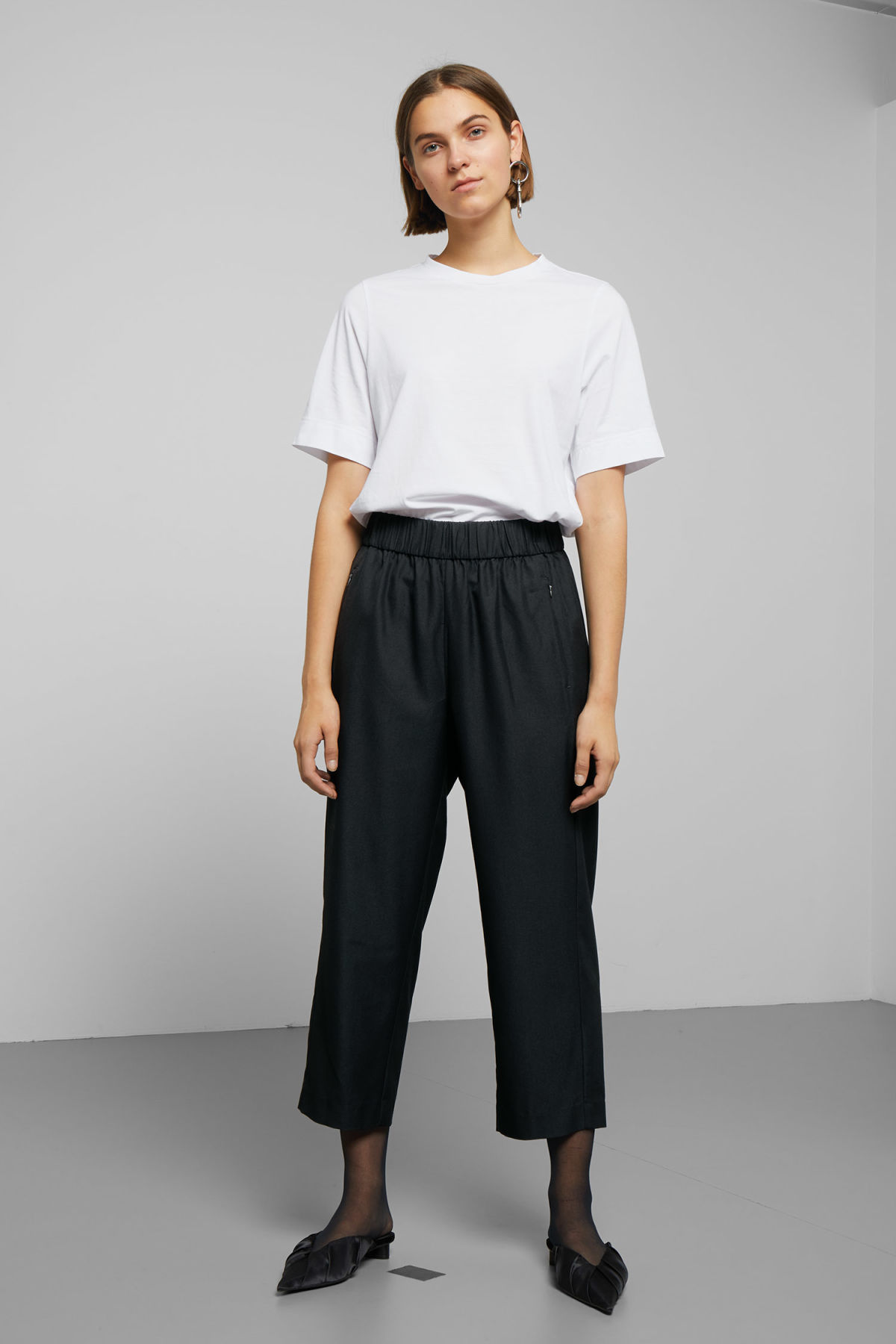 Model front image of Weekday amelia woven trousers in black