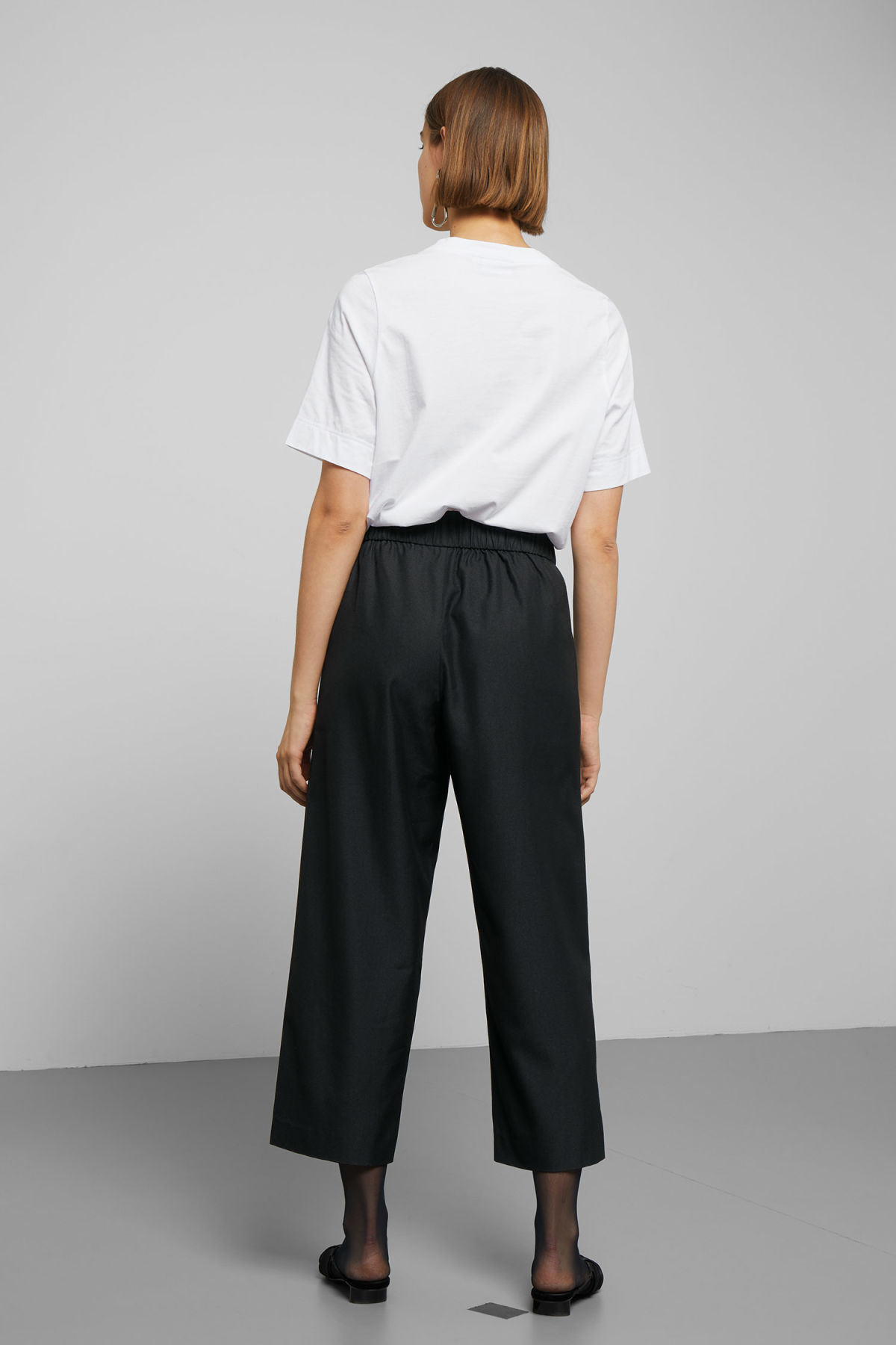 Model back image of Weekday amelia woven trousers in black