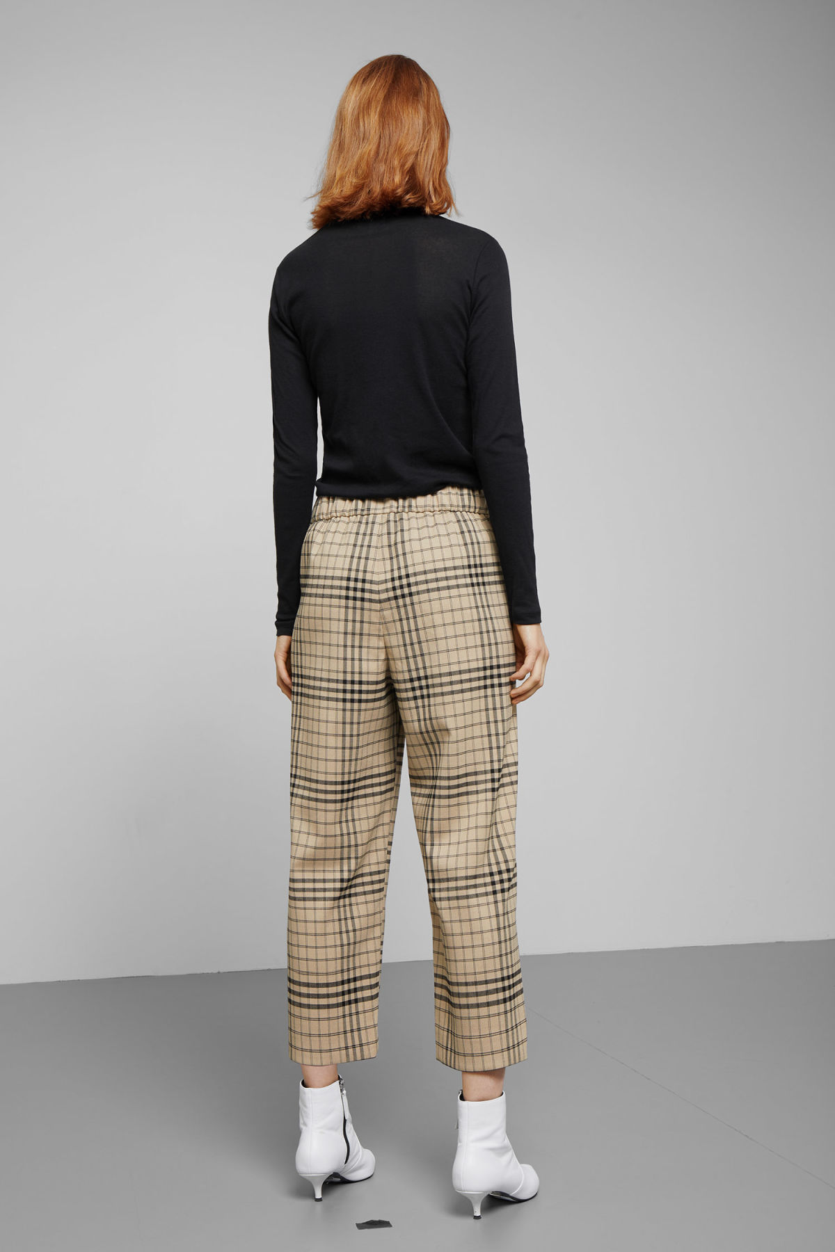 Model side image of Weekday amelia woven trousers in beige