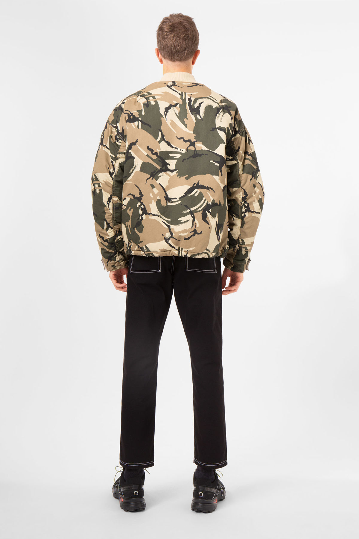 Model side image of Weekday even camo bomber in green
