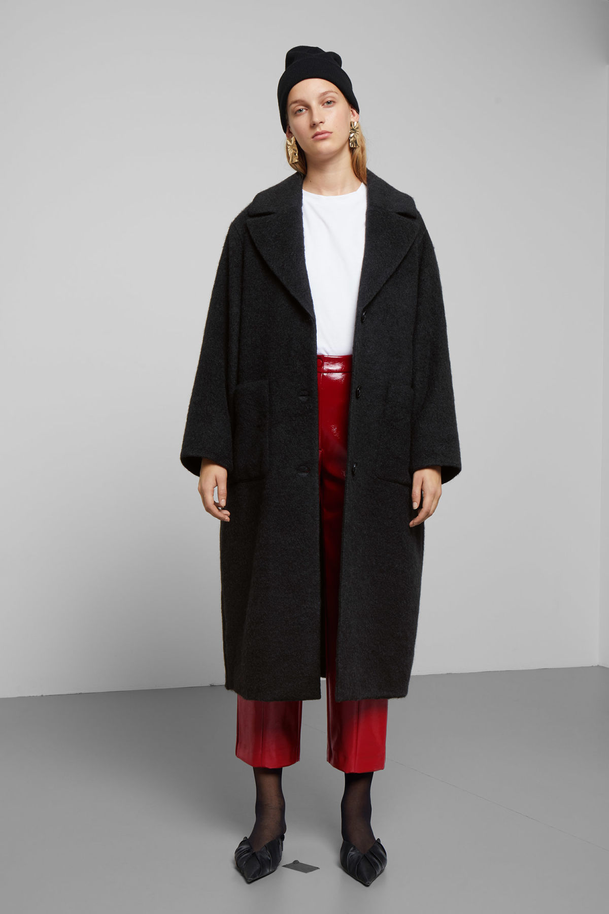 Model front image of Weekday mario coat in black