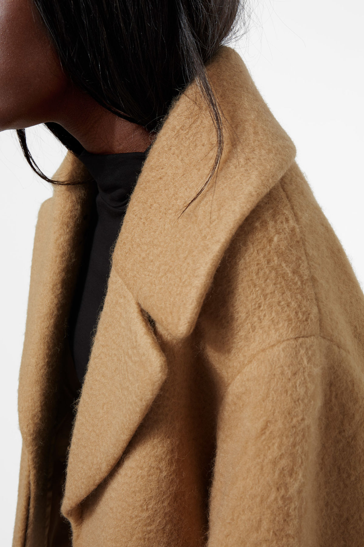 Model side image of Weekday mario coat in beige