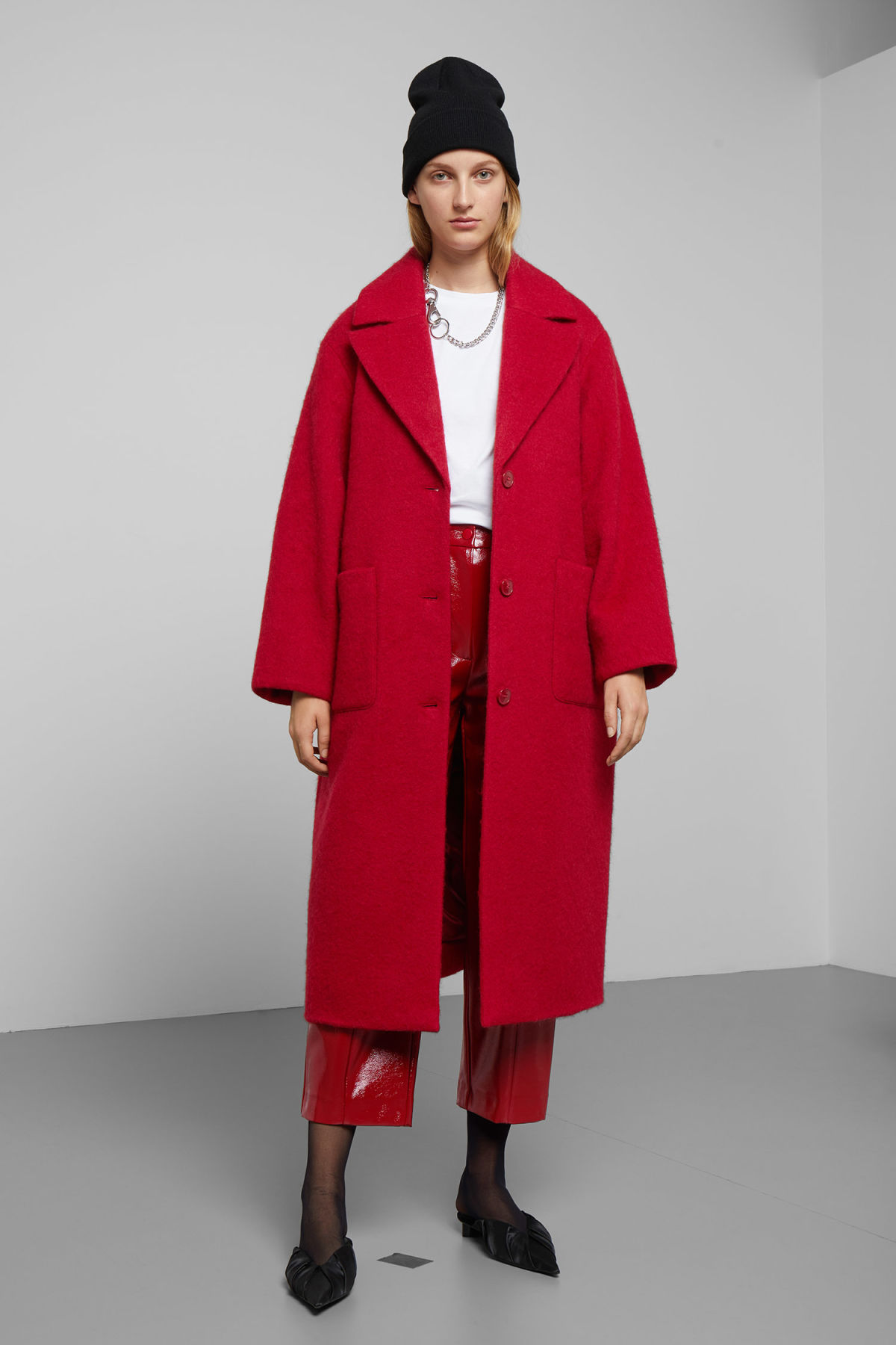 Model back image of Weekday mario coat in red