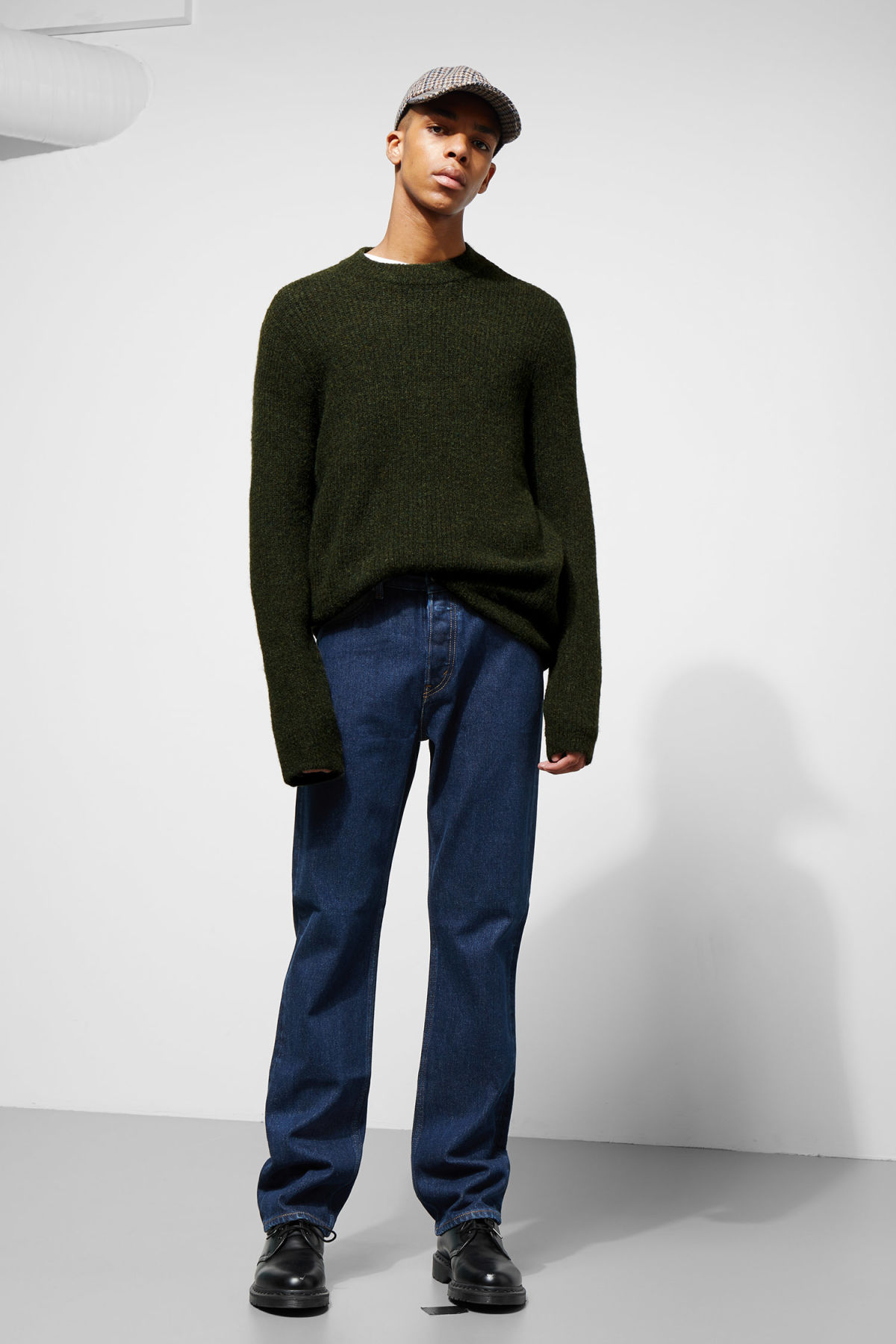 Model side image of Weekday mino sweater in green