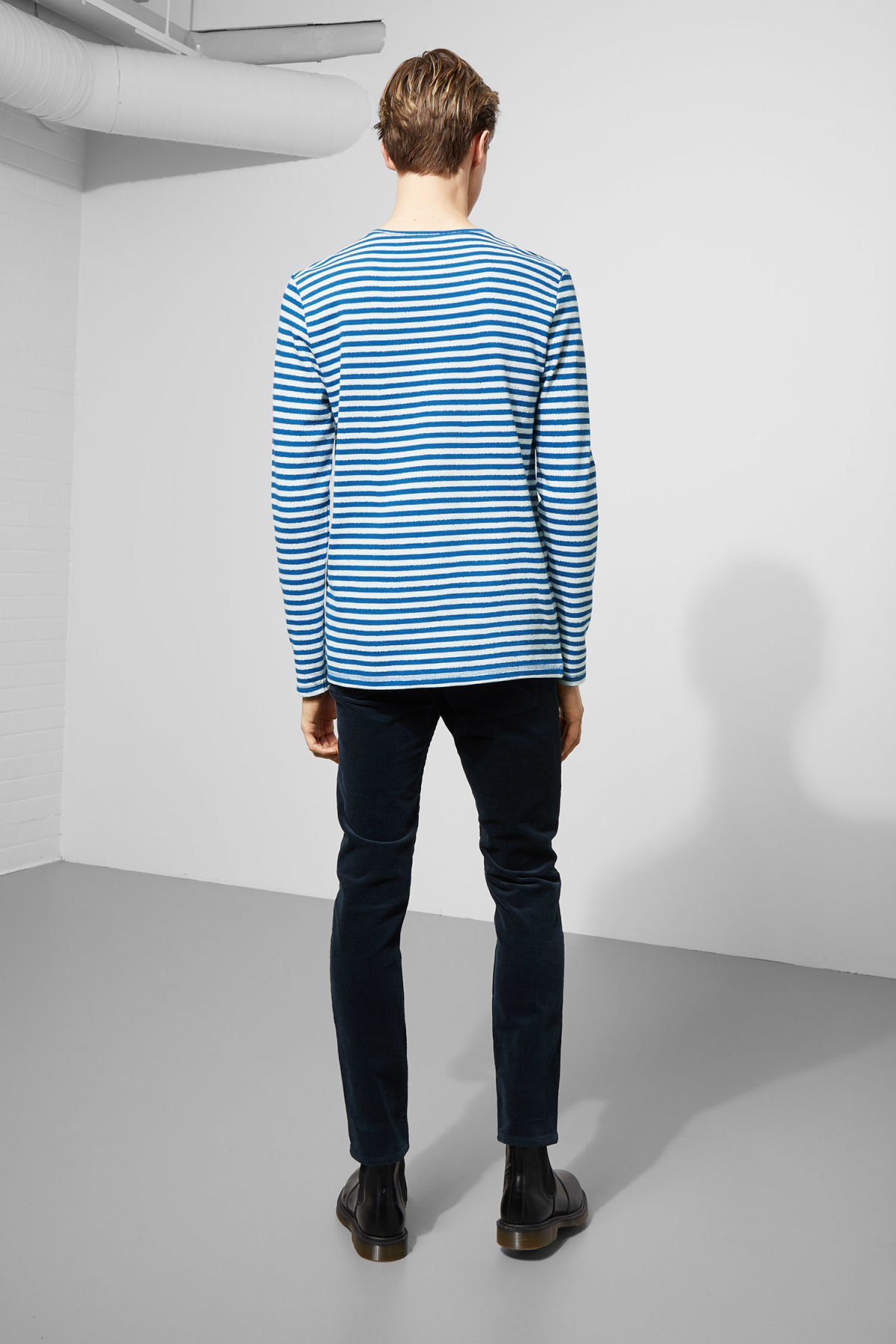 Model side image of Weekday carter sweatshirt in blue