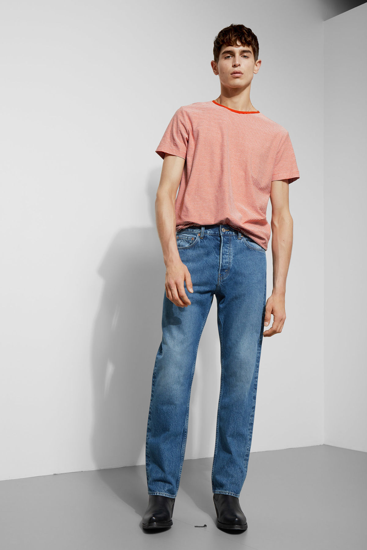 Model side image of Weekday darko stripe t-shirt in orange