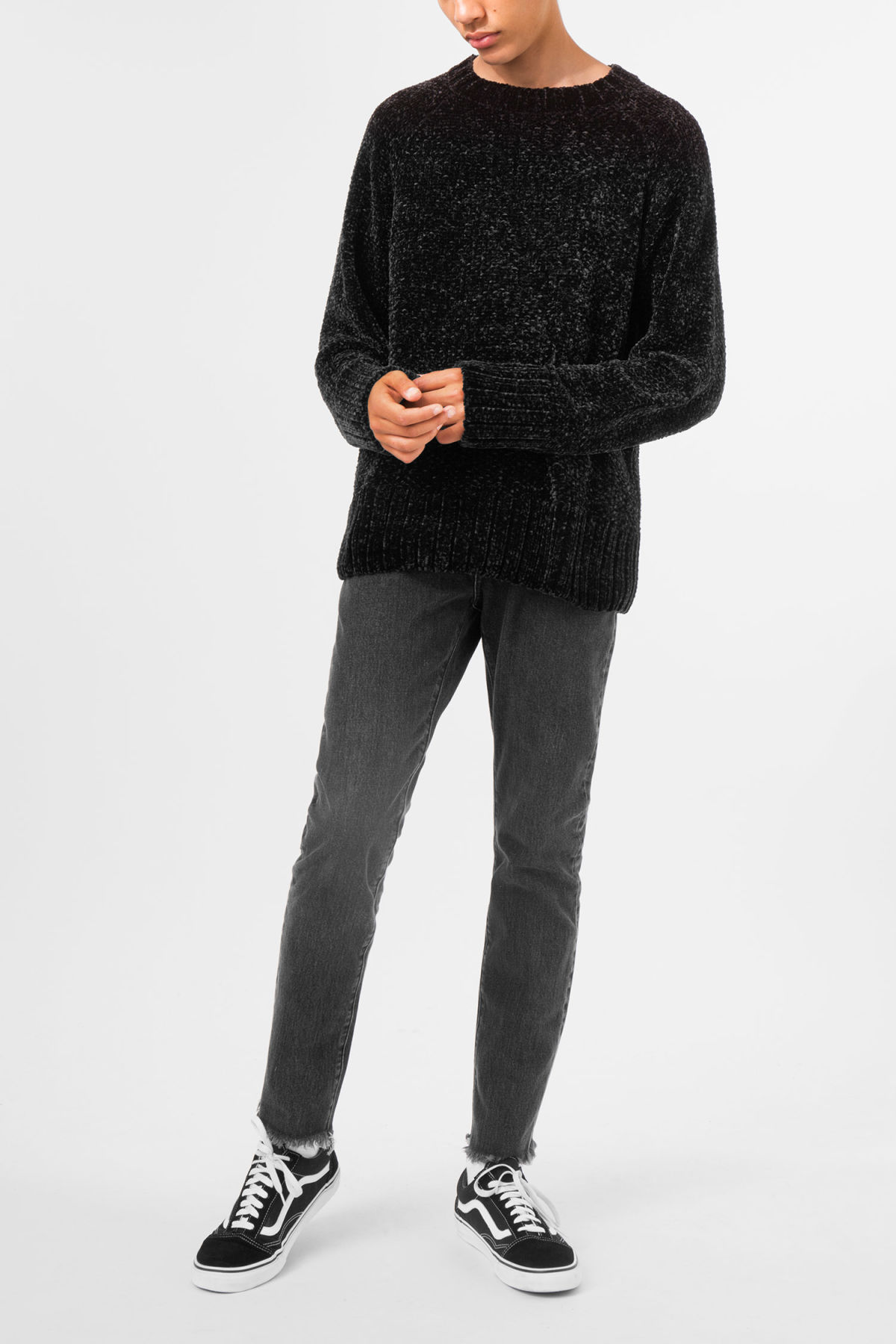 Model side image of Weekday chenille sweater in black