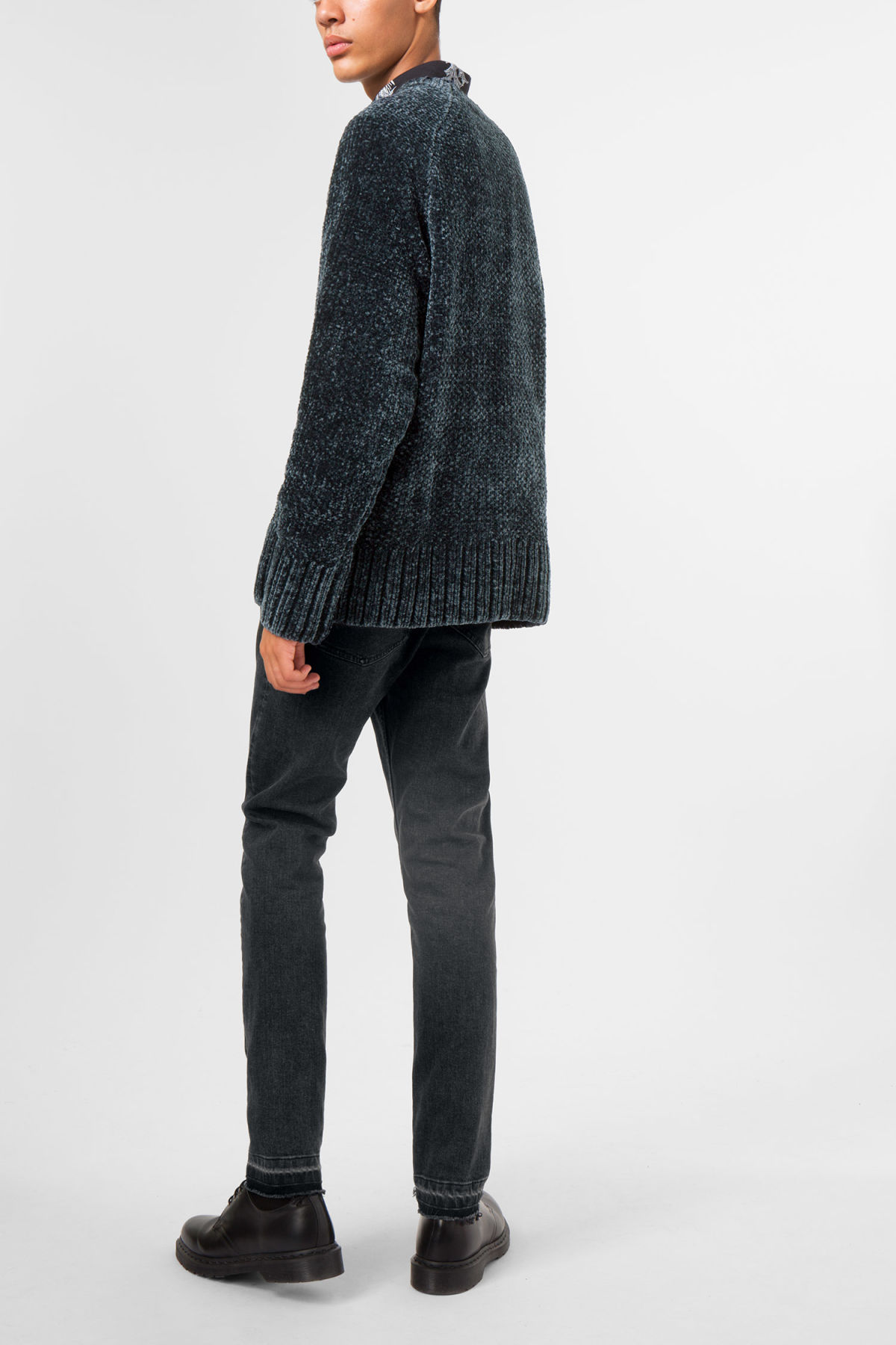 Model side image of Weekday chenille sweater in blue