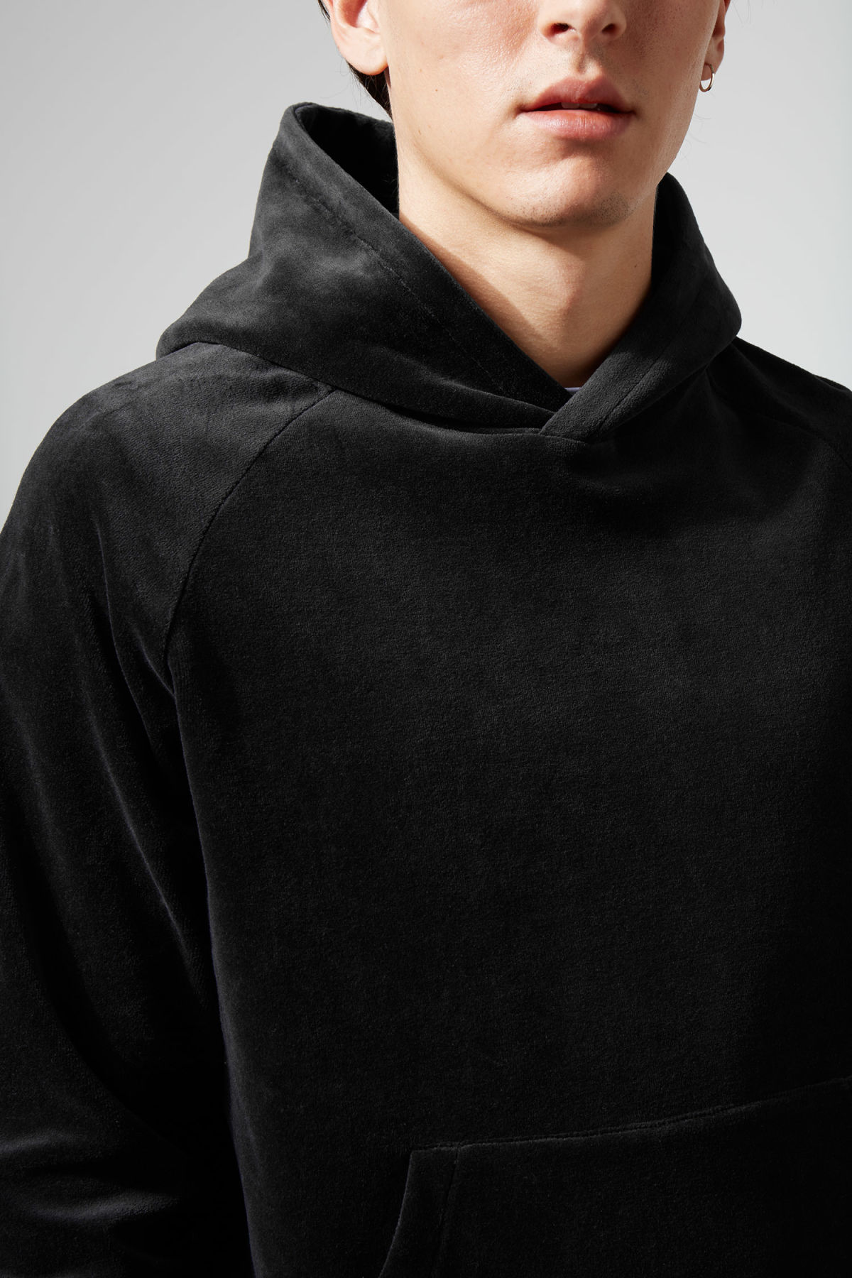 Model side image of Weekday noah velvet hoodie in black