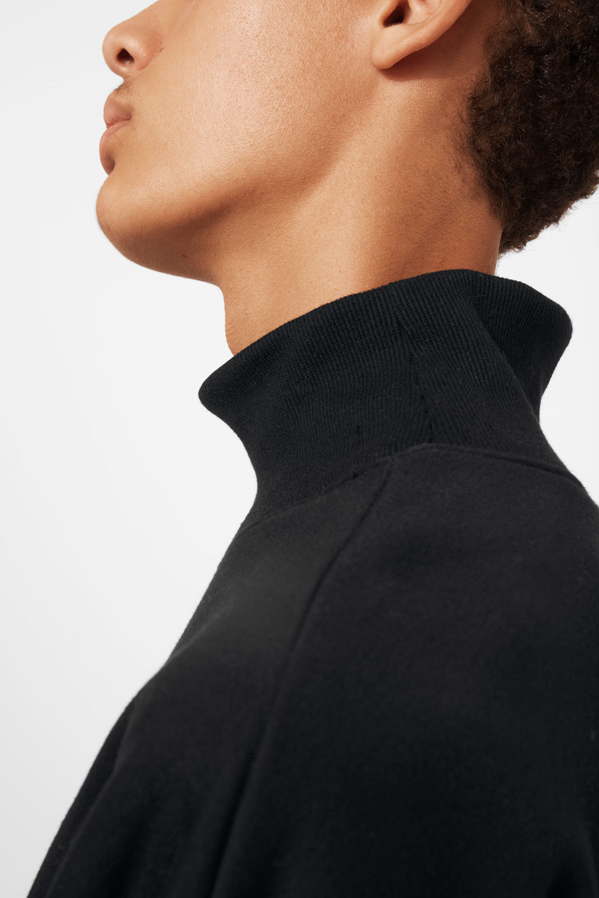 Model side image of Weekday big turtleneck sweatshirt in black