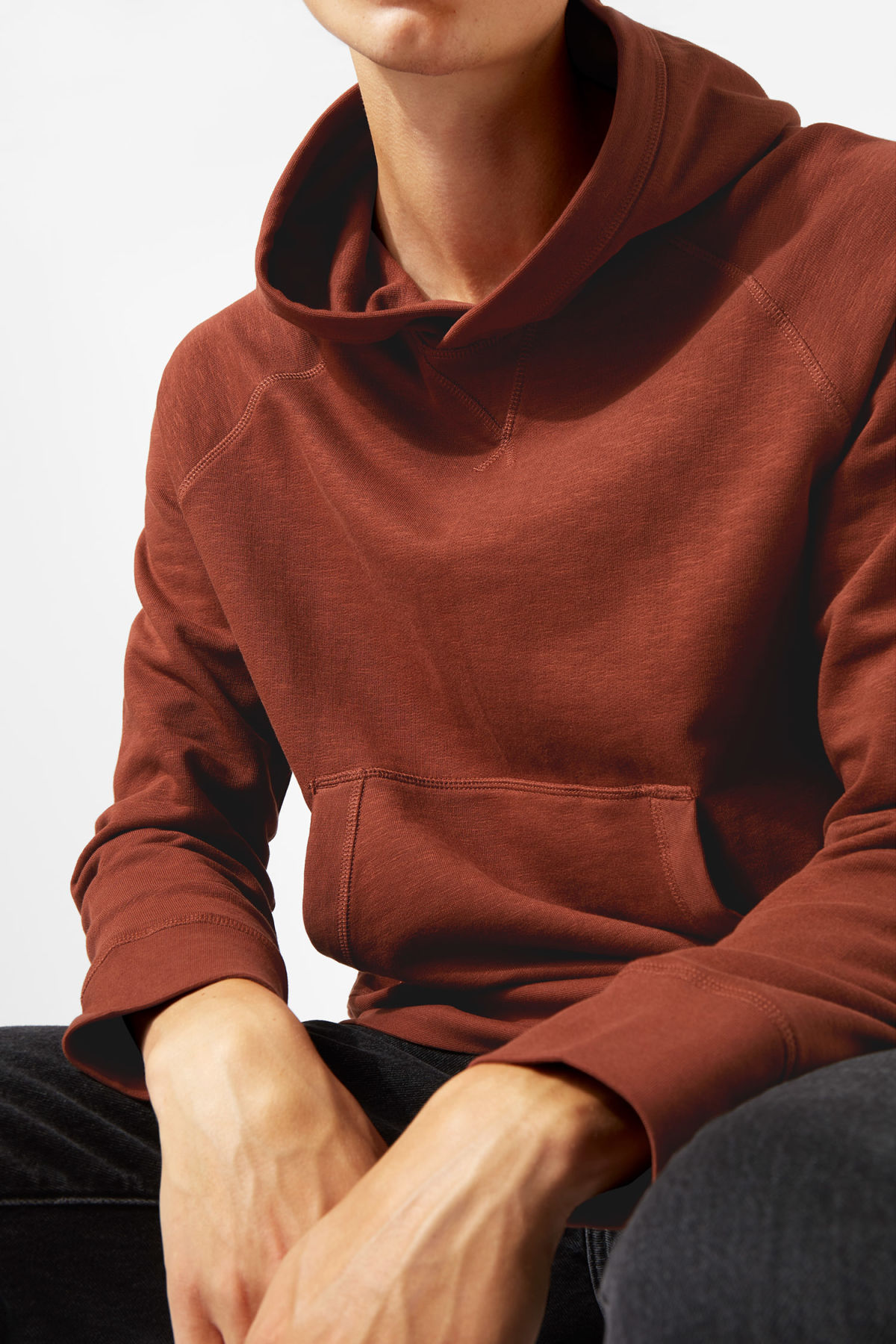 Model side image of Weekday noah hoodie in orange
