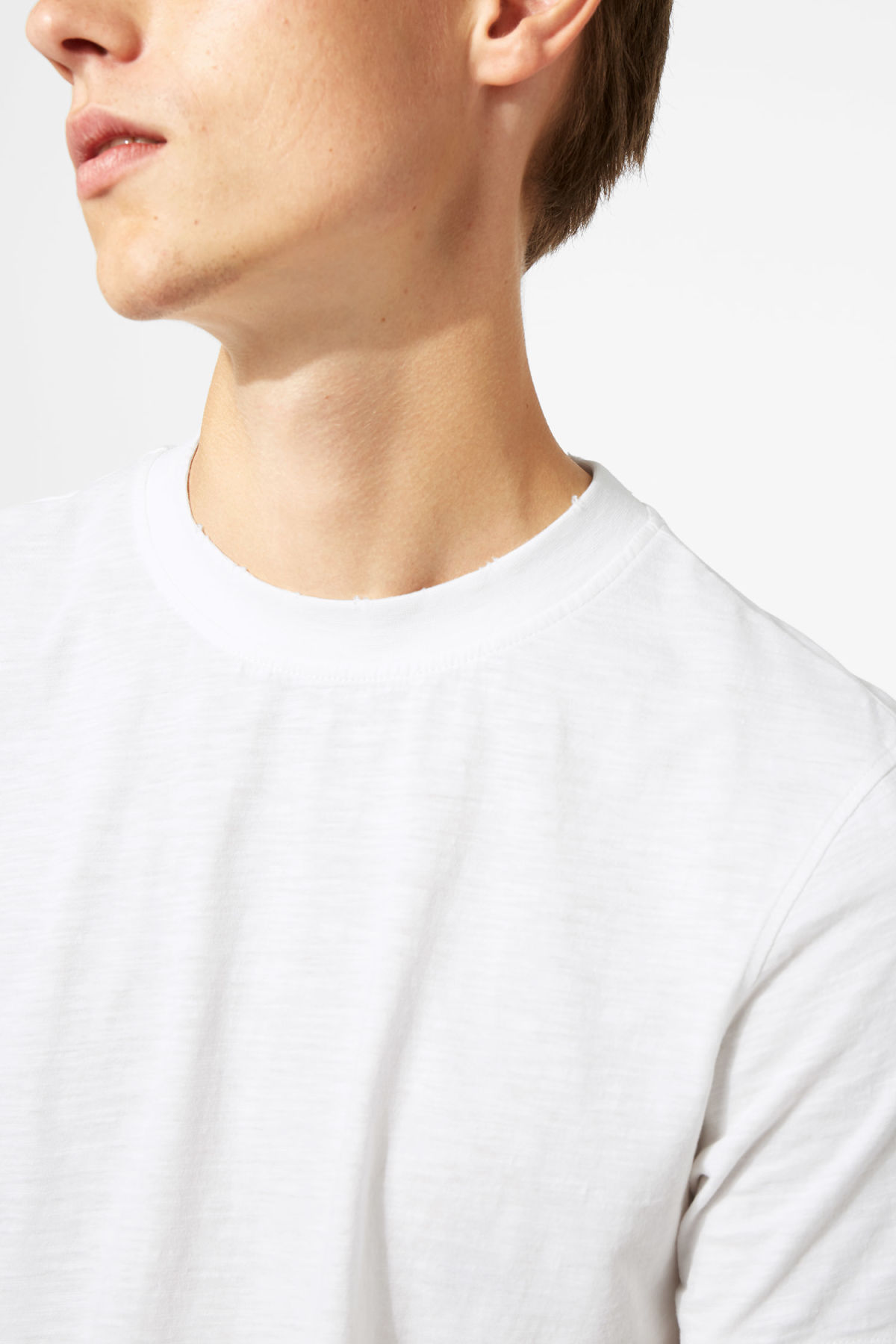 Model side image of Weekday bob broken t-shirt in white
