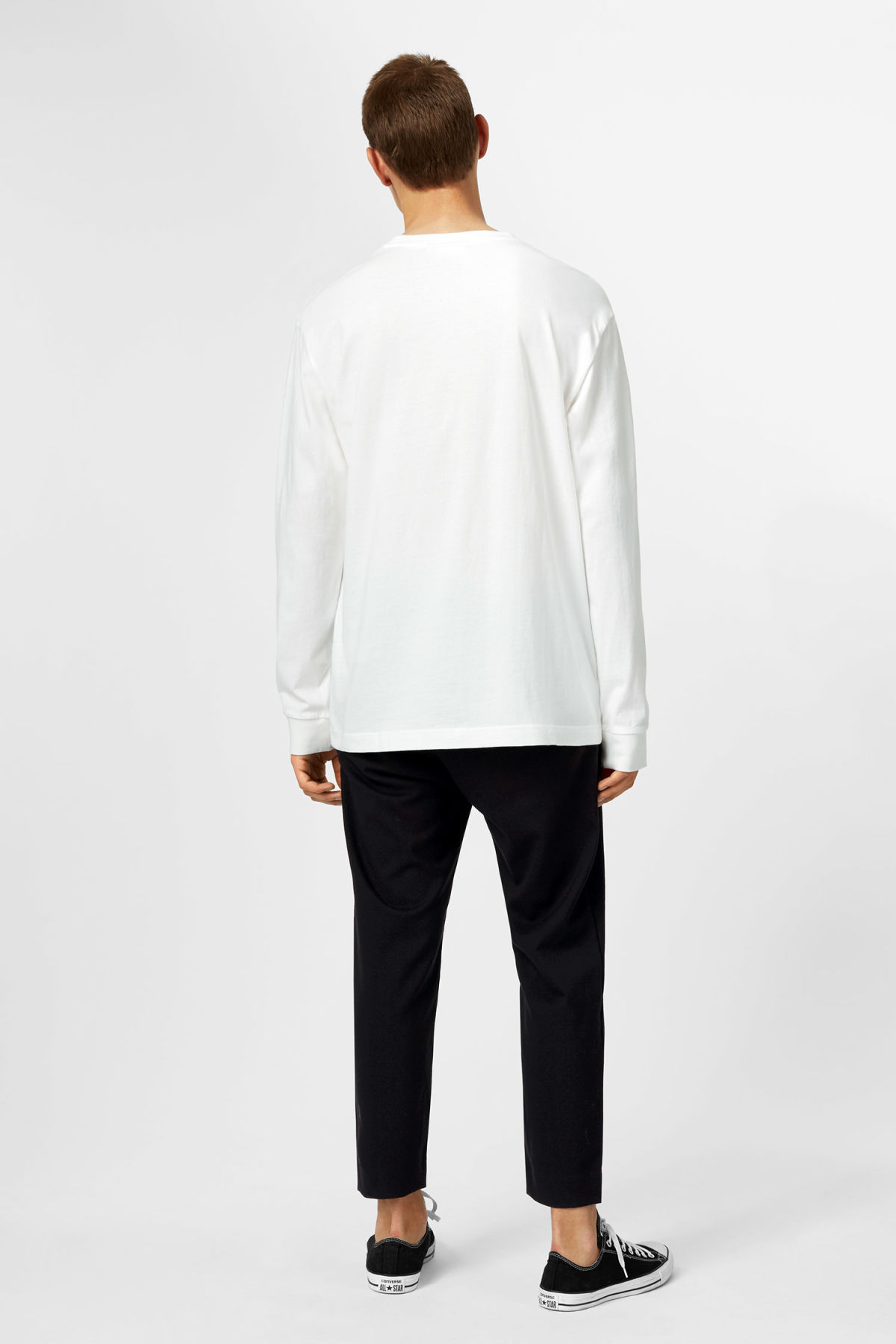 Model side image of Weekday joseph long sleeve in white