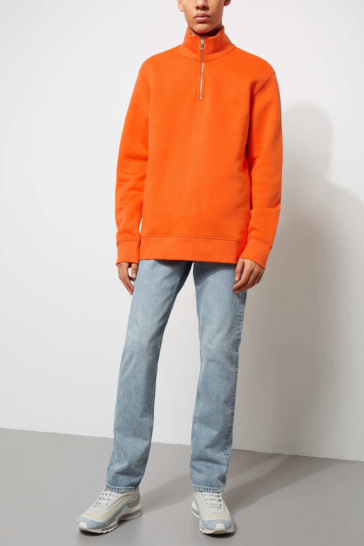 Model side image of Weekday martin zip sweatshirt  in orange