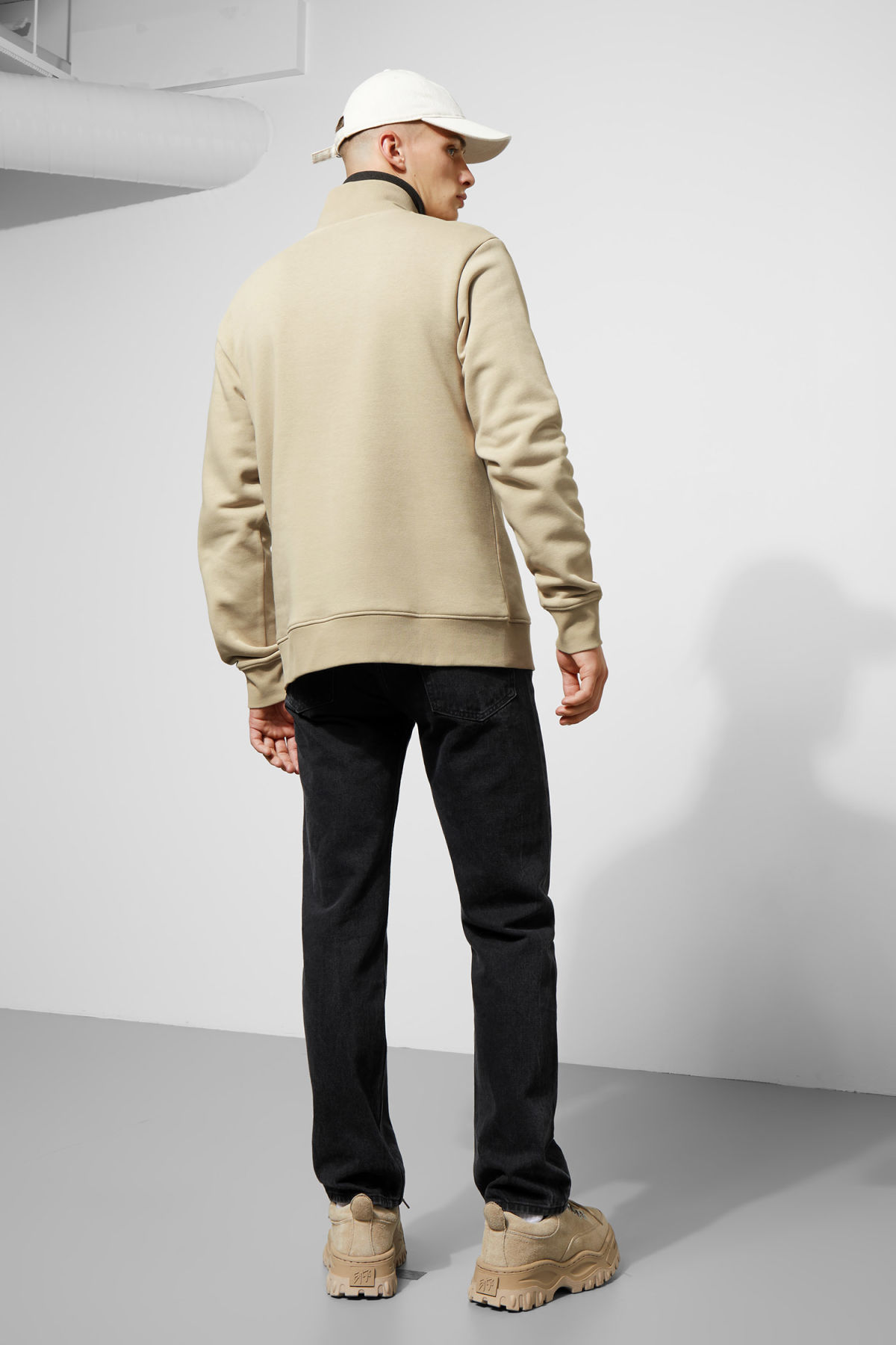 Model side image of Weekday martin zip sweatshirt  in brown