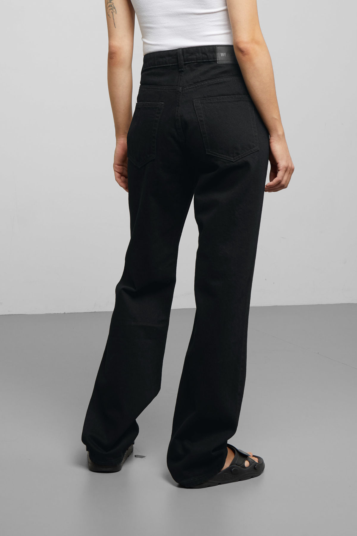 Model side image of Weekday voyage black jeans in black