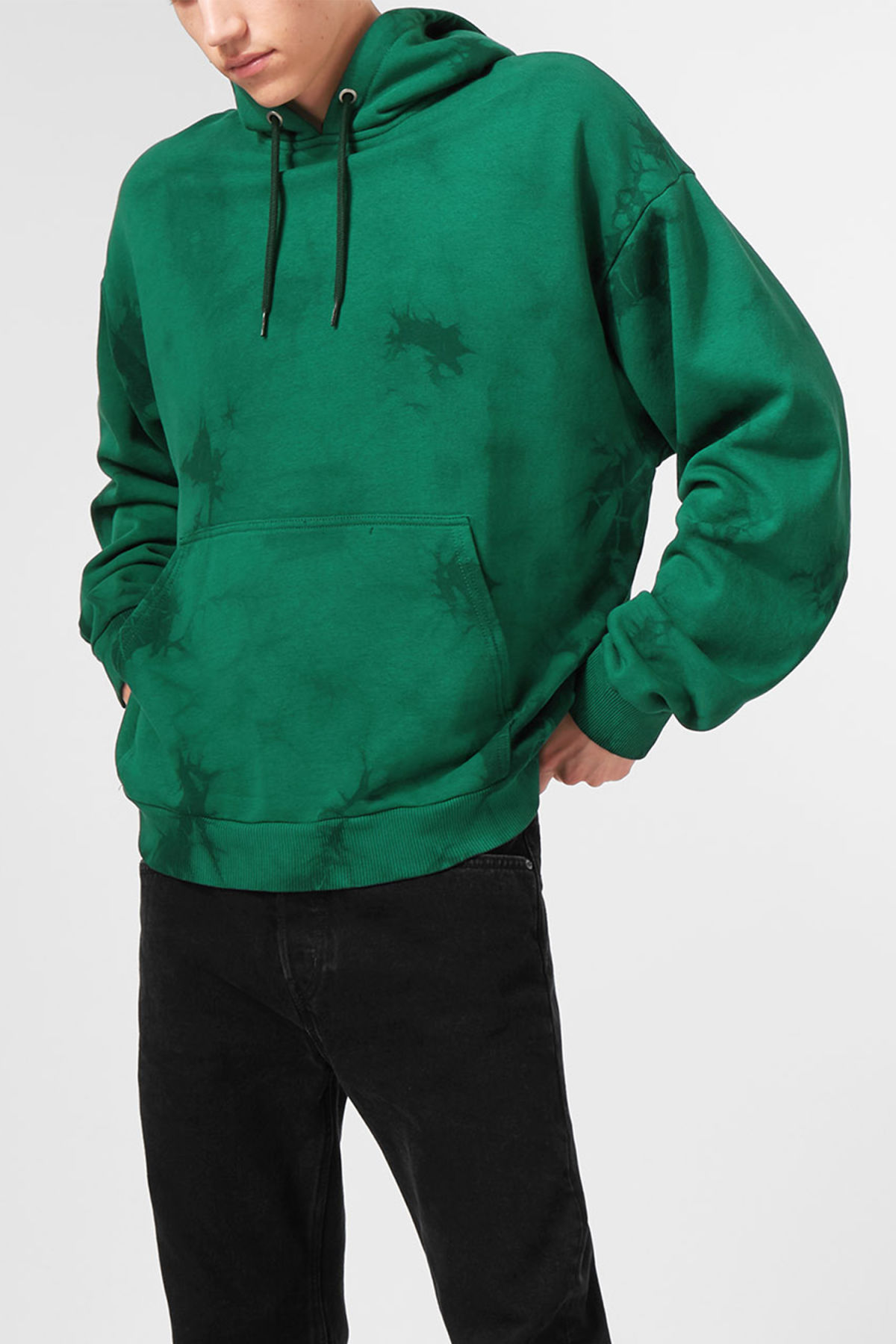 Model front image of Weekday big hawk tie dye hoodie in green