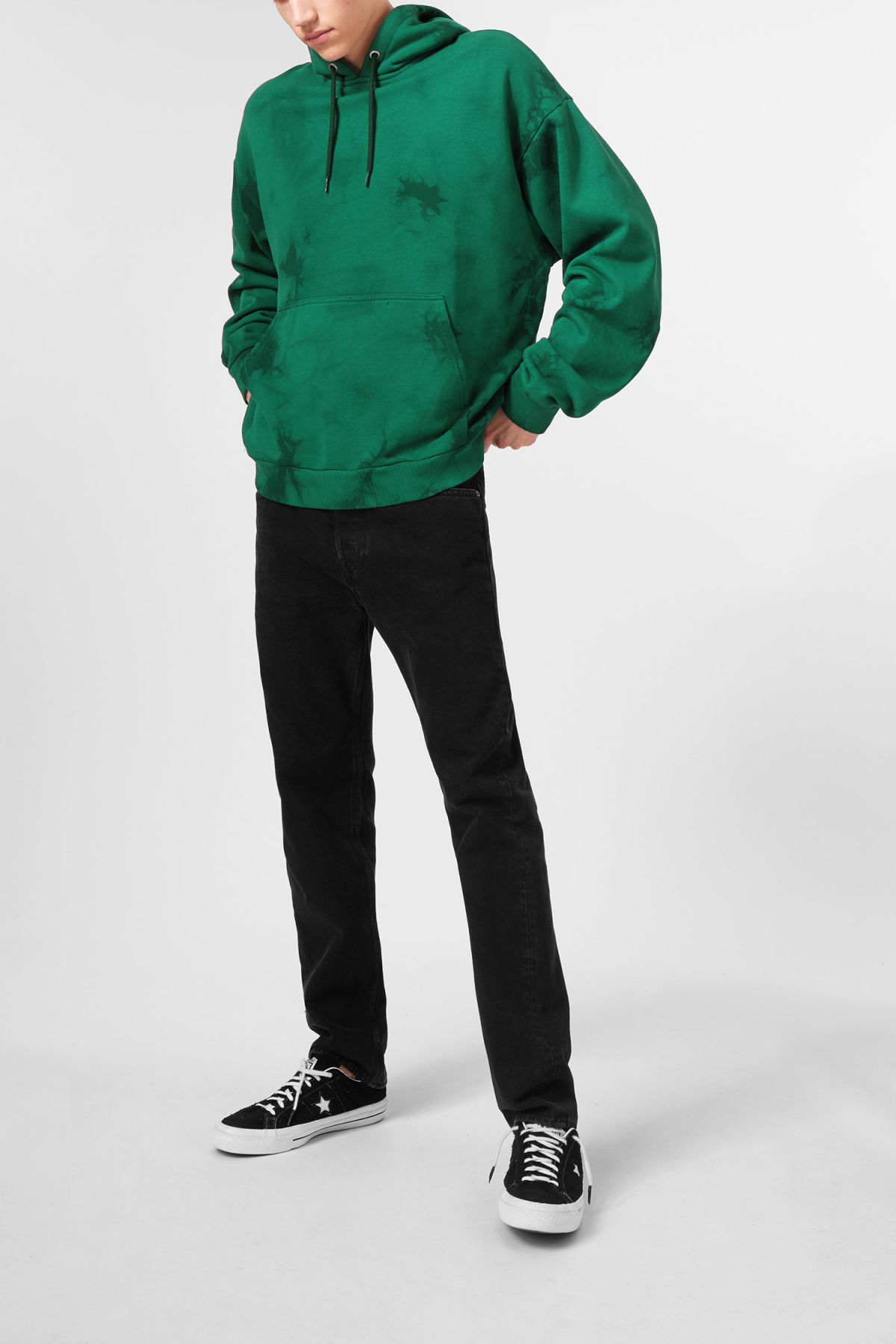 Model side image of Weekday big hawk tie dye hoodie in green