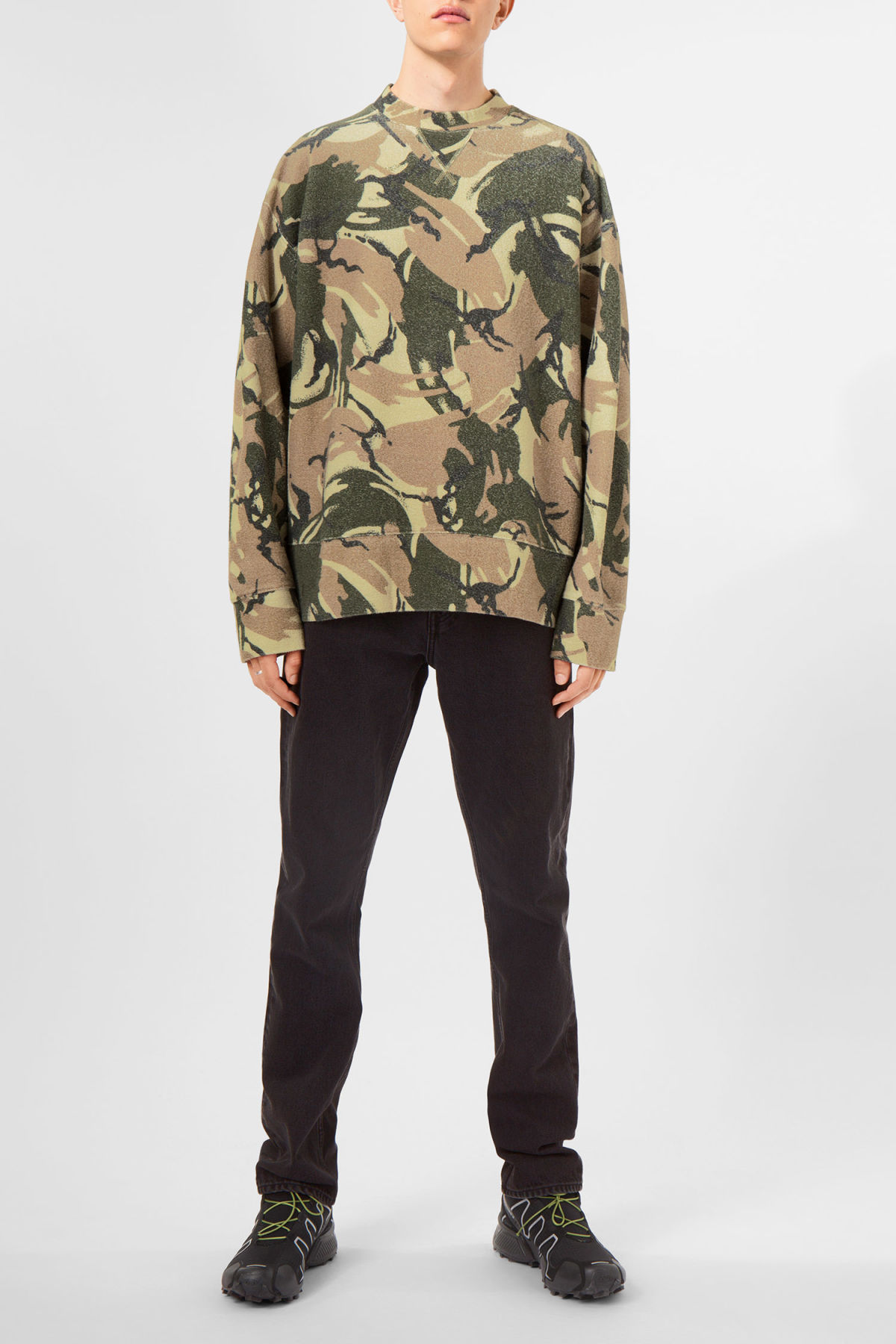 Model side image of Weekday kyle camo sweatshirt in green