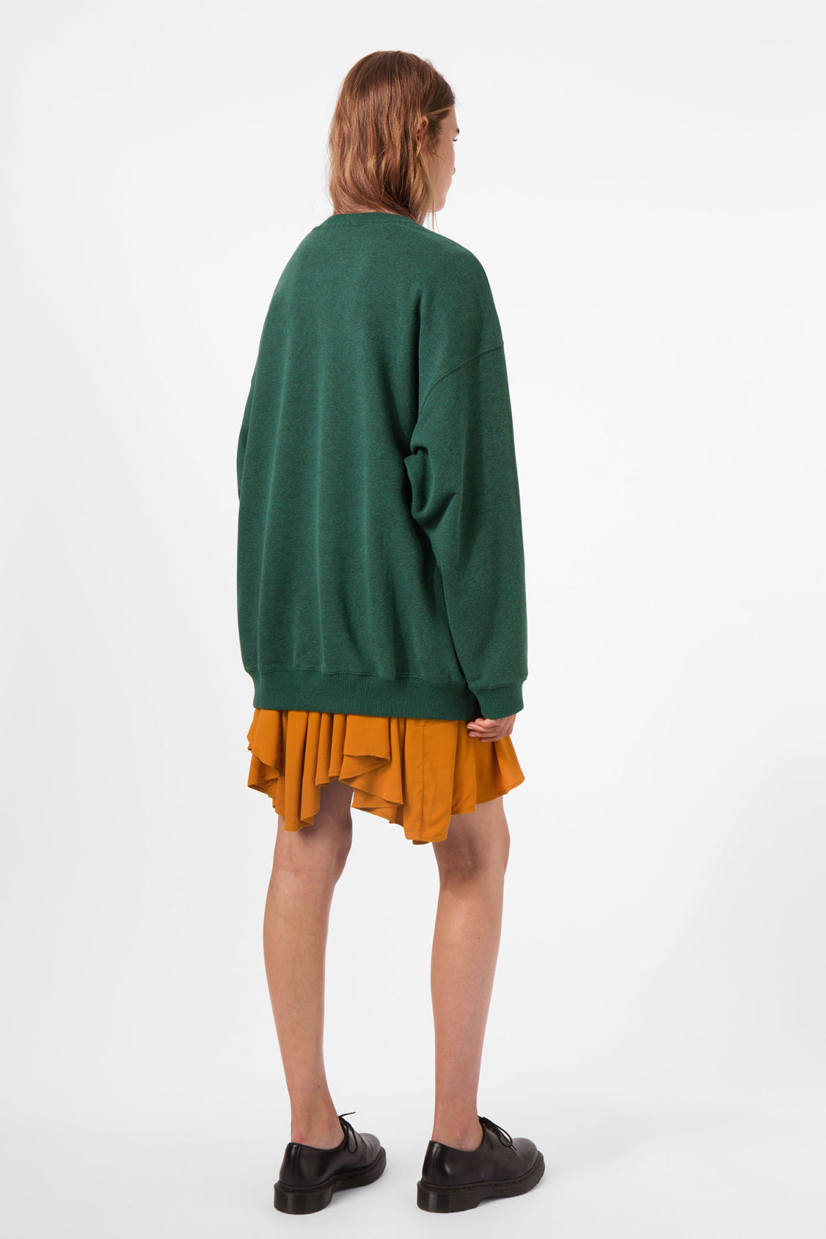 Model side image of Weekday kalin sweatshirt in green