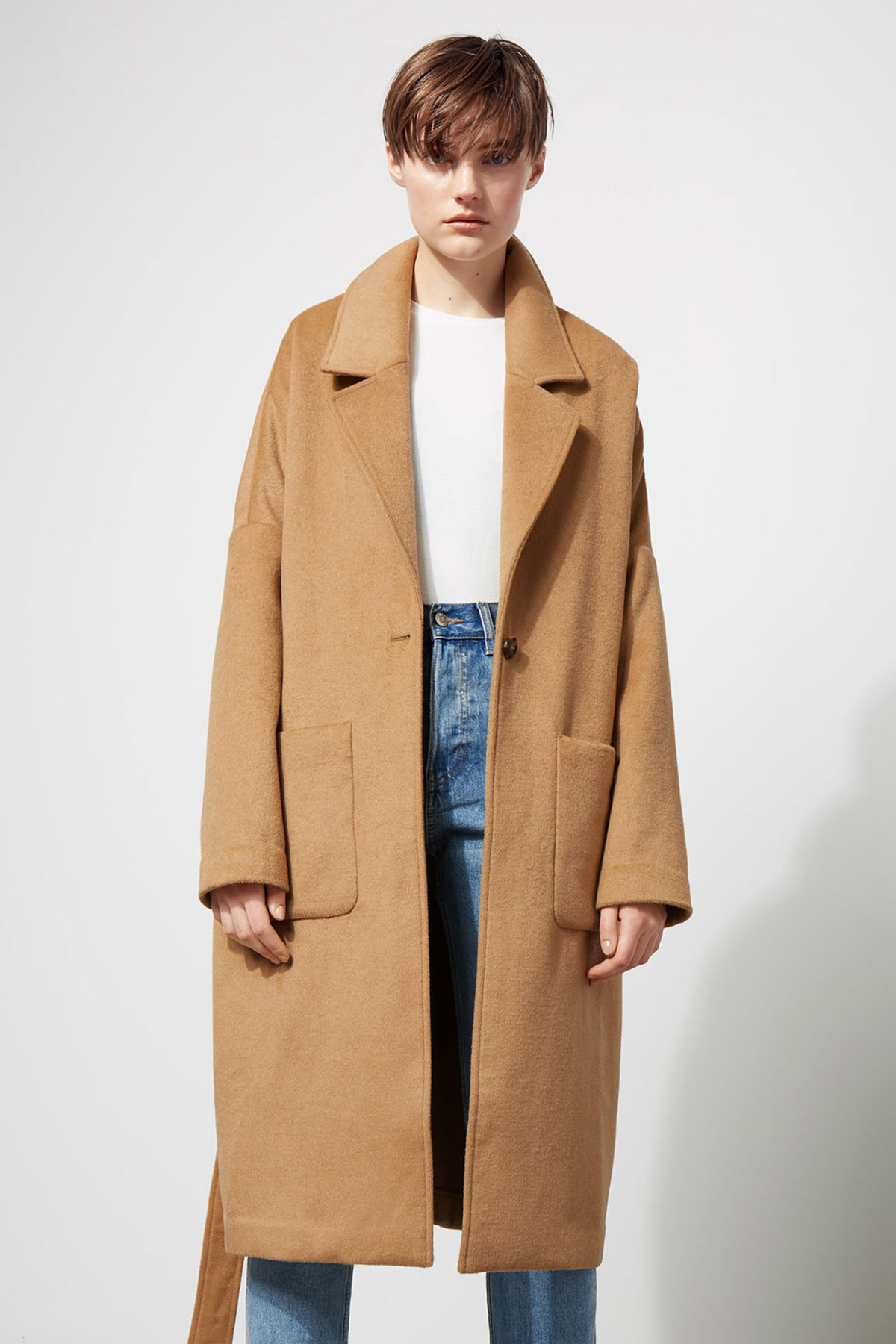 Model front image of Weekday gry coat in beige