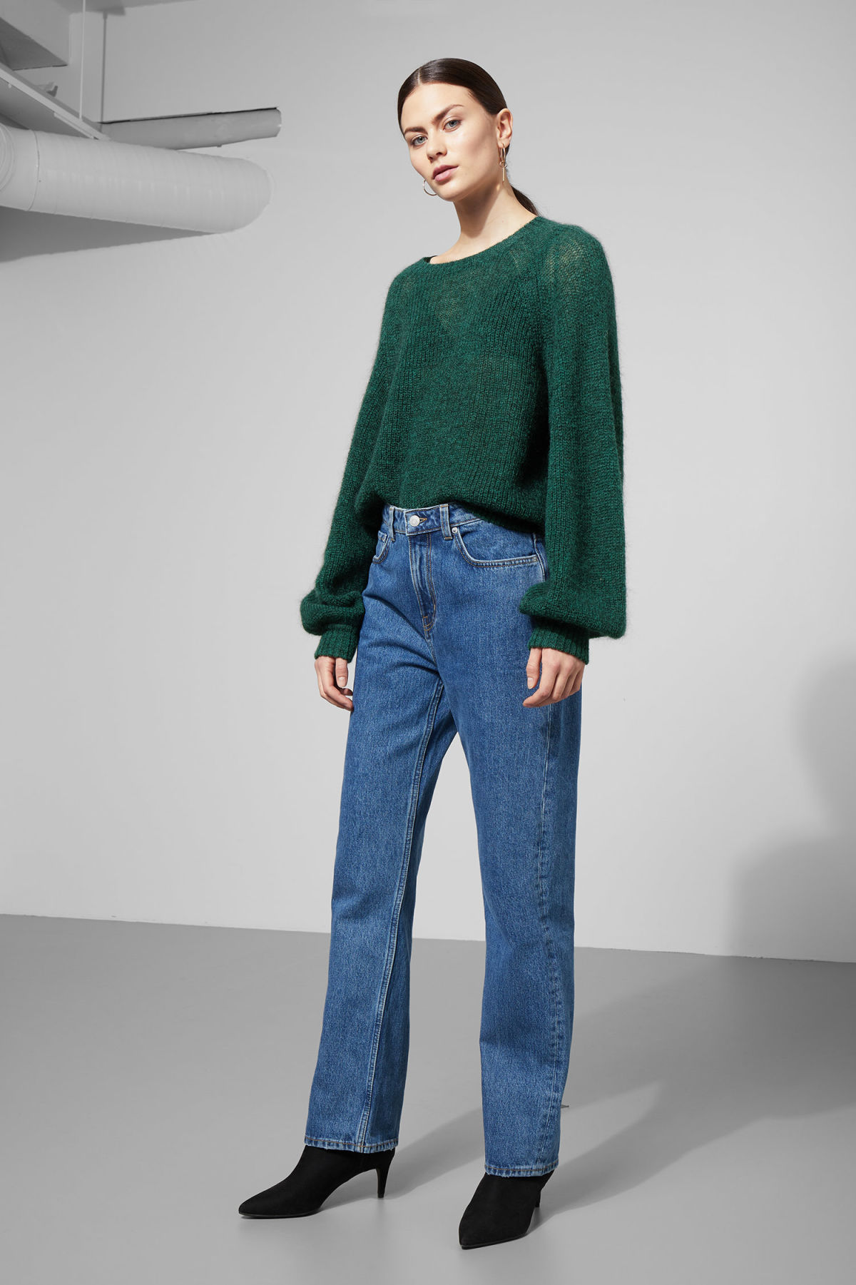 Model side image of Weekday joni sweater in green