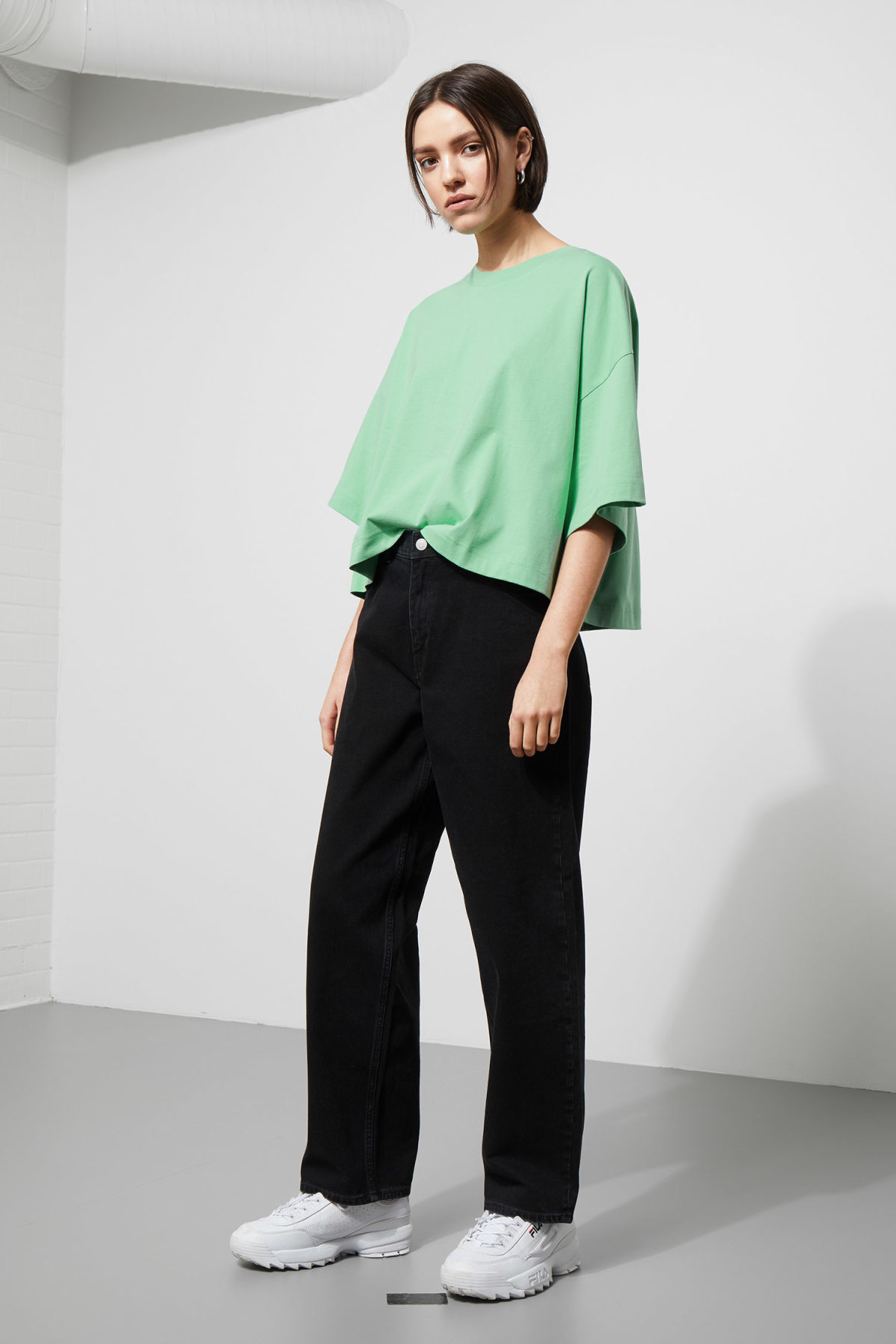 Model side image of Weekday huge t-shirt in green