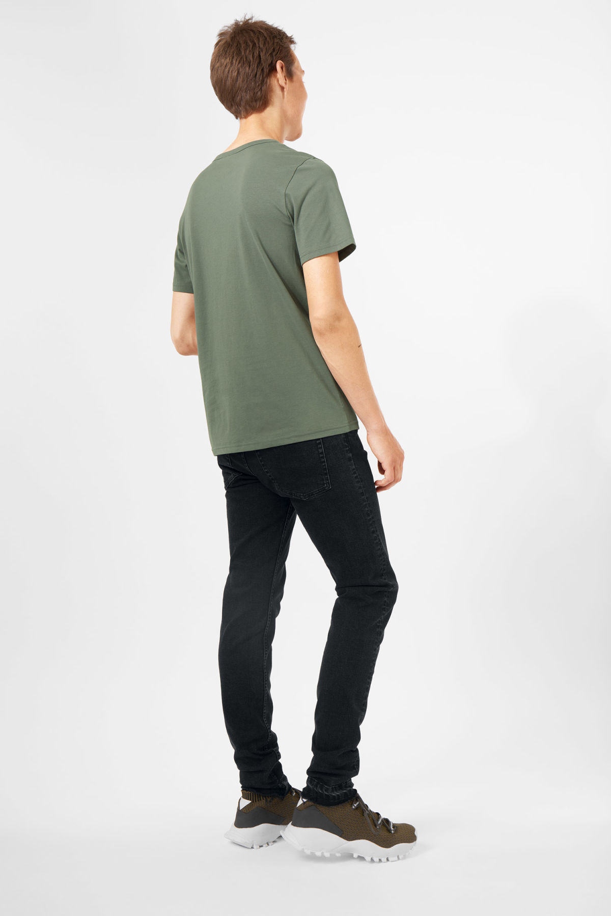 Model side image of Weekday lee t-shirt in green
