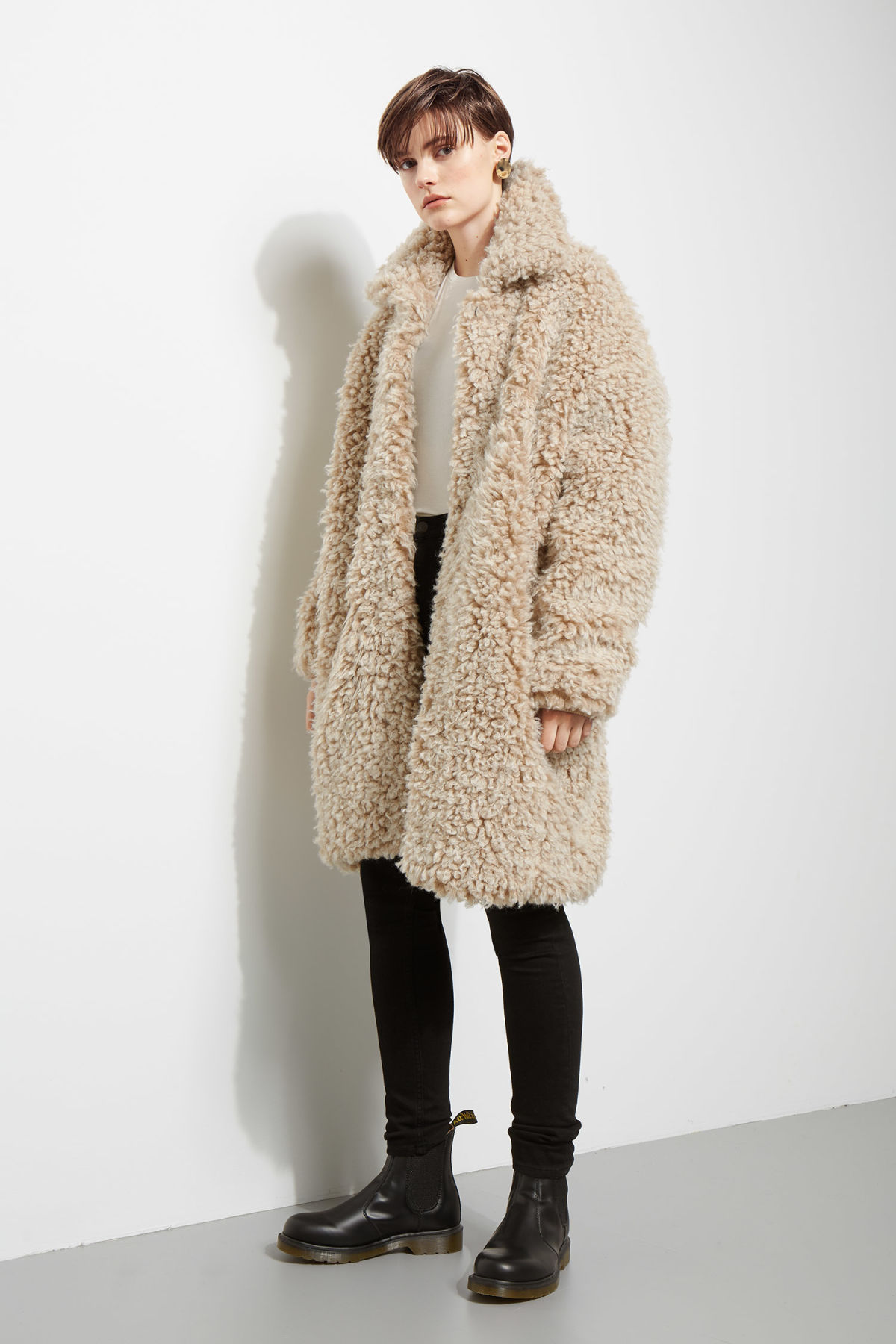 Model front image of Weekday janis fur coat in white