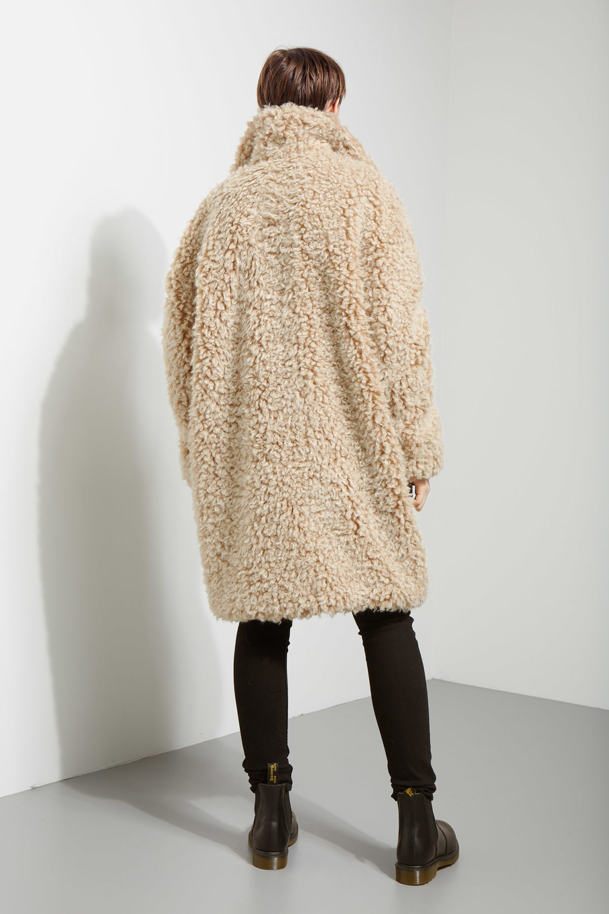 Model side image of Weekday janis fur coat in white