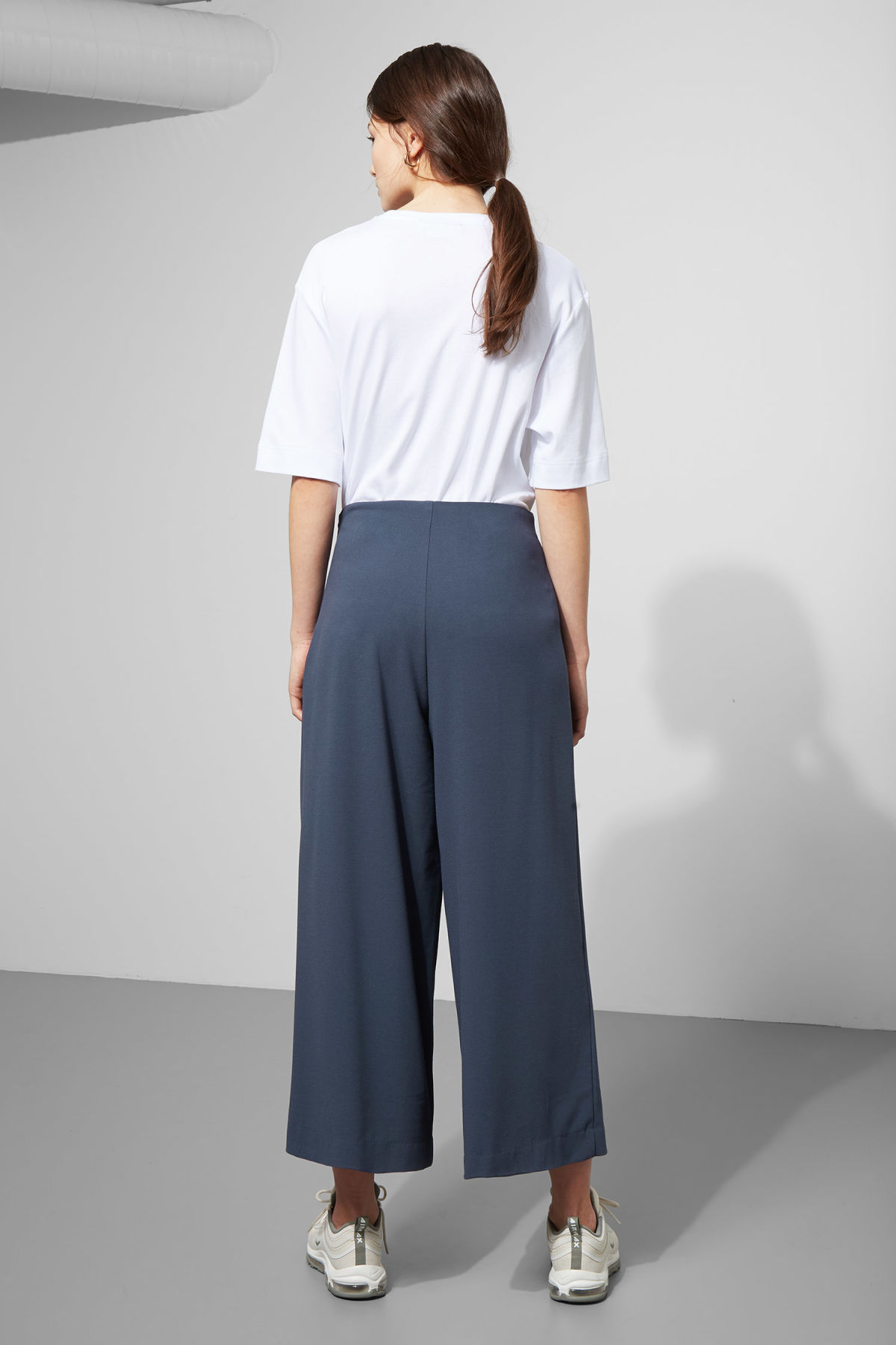 Model side image of Weekday jazz trousers in blue