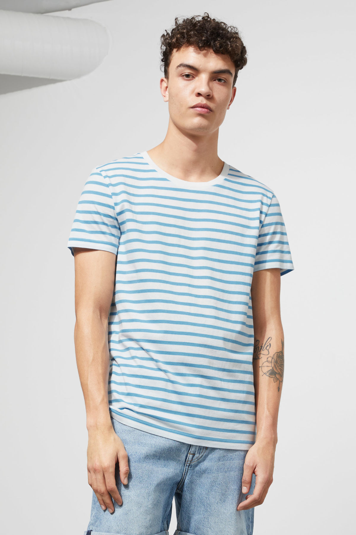 Model front image of Weekday alex stripe t-shirt in blue