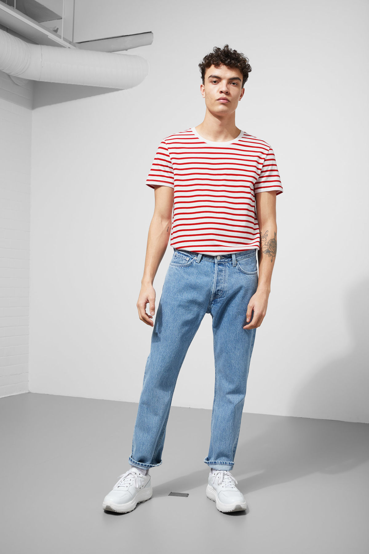 Model side image of Weekday alex stripe t-shirt in red