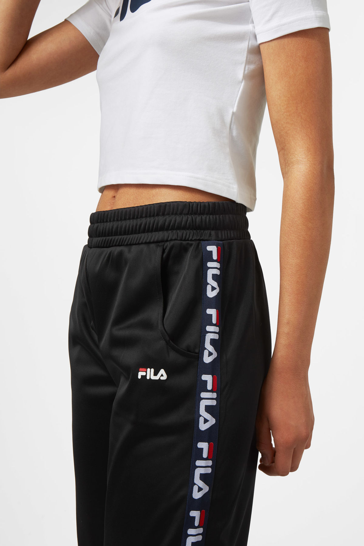 Model side image of Weekday strap track pants in black