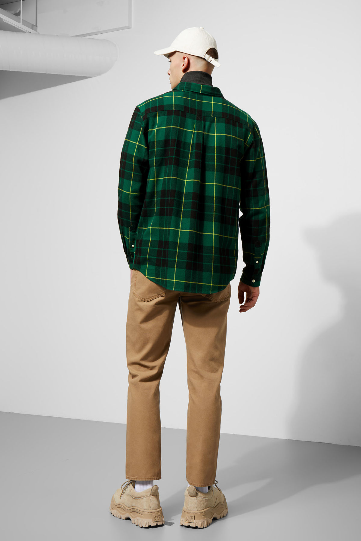 Model side image of Weekday seattle check shirt in green