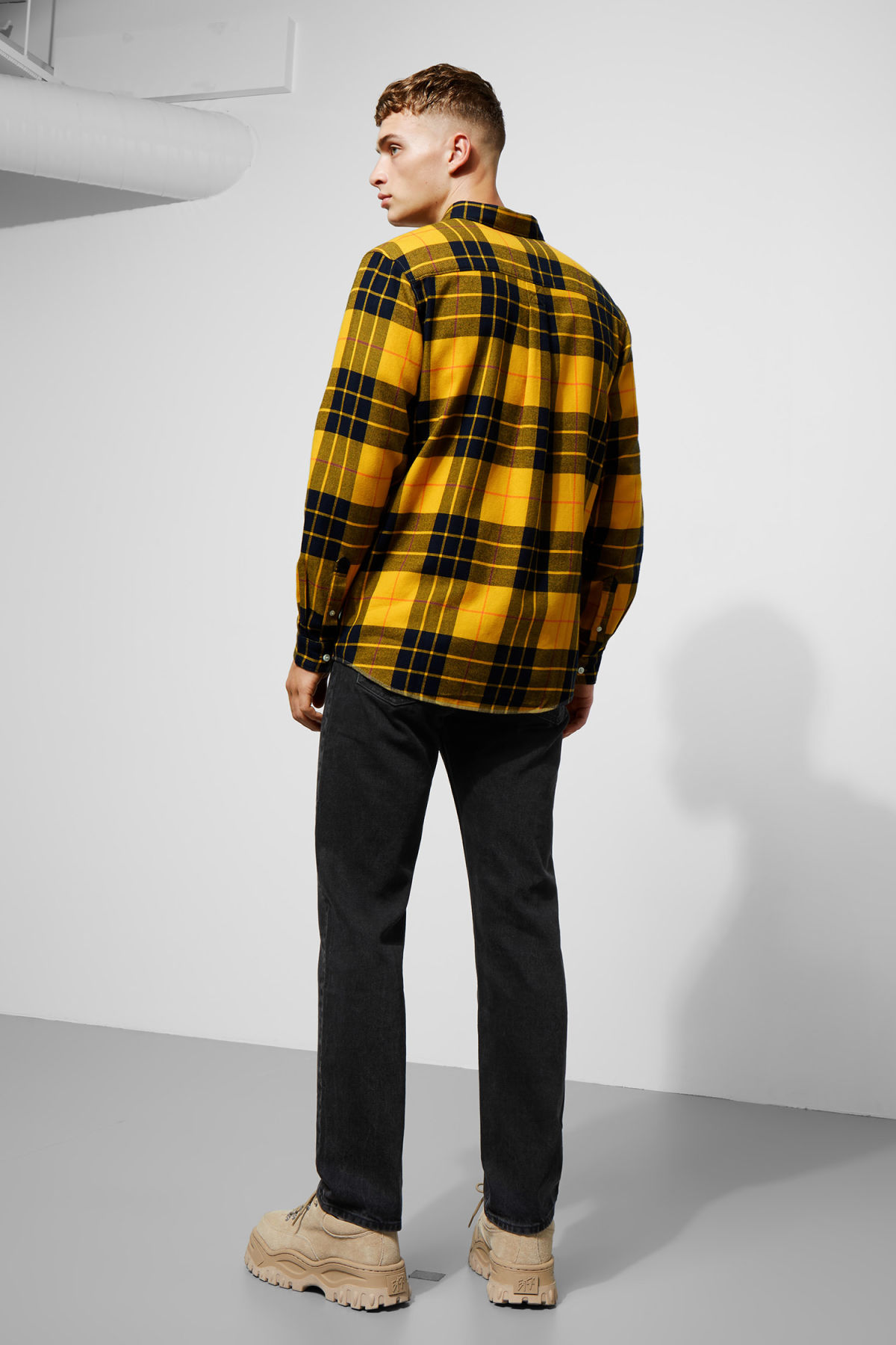 Model side image of Weekday seattle check shirt in yellow