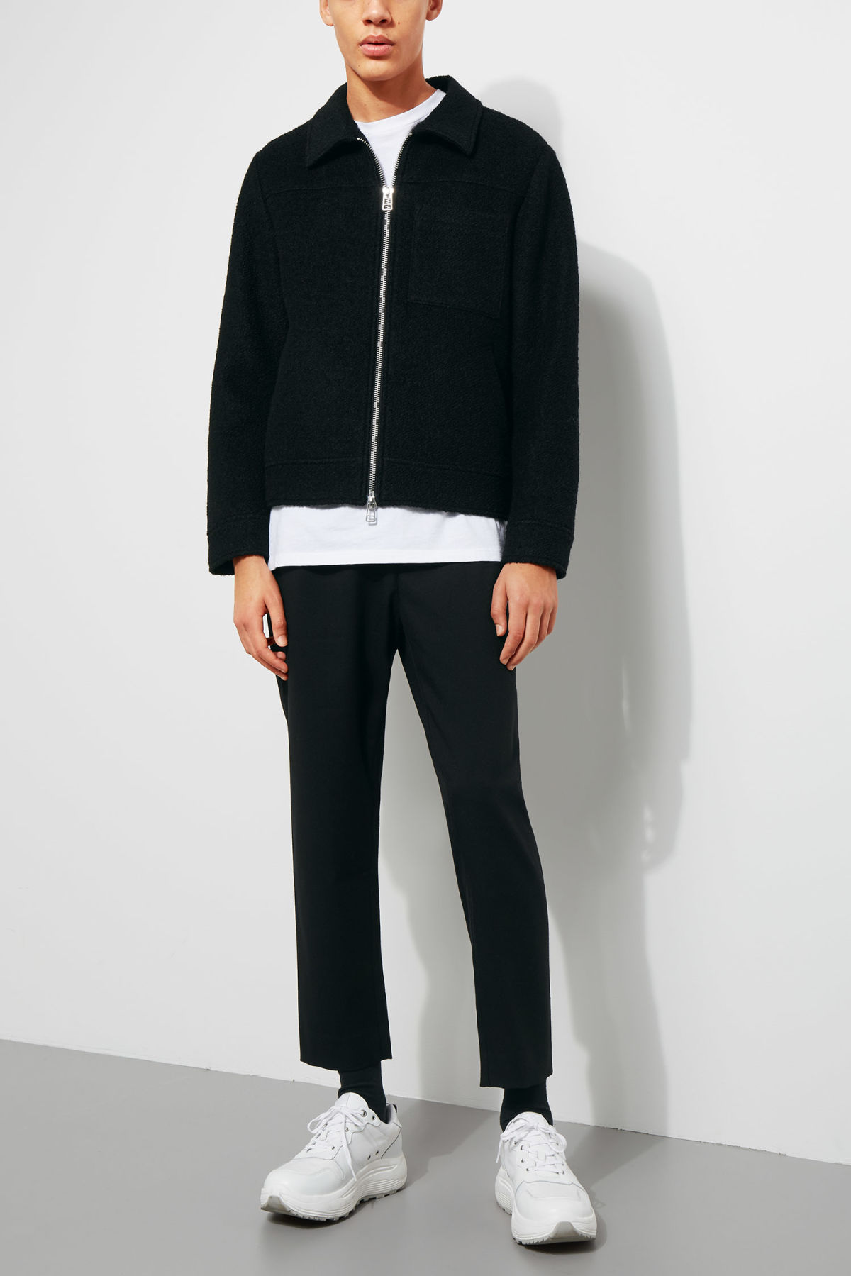 Model side image of Weekday merz jacket in black