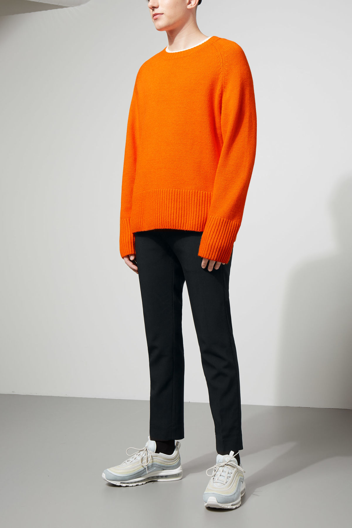 Model side image of Weekday mural sweater in orange