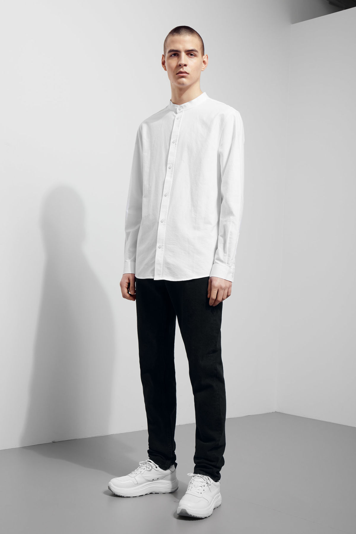Model side image of Weekday haring collarless shirt in white