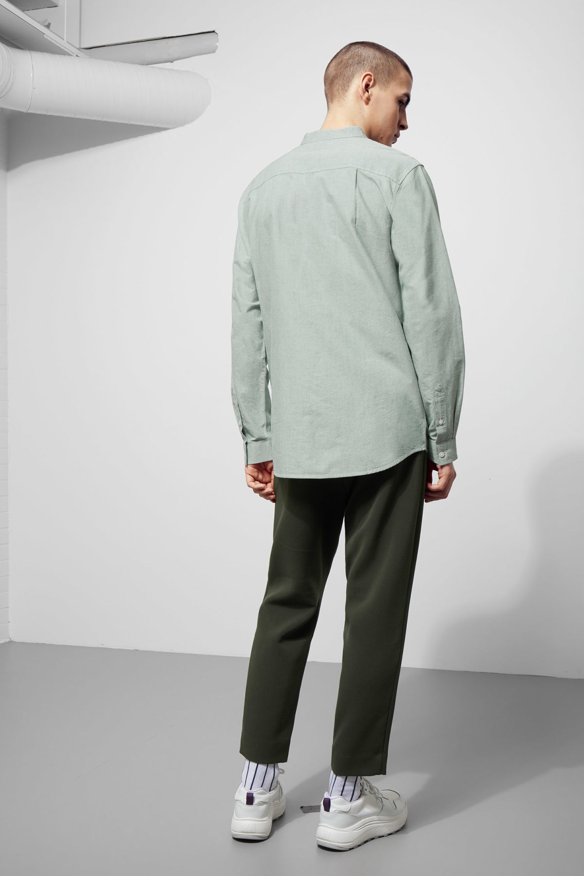Model back image of Weekday haring collarless shirt in green