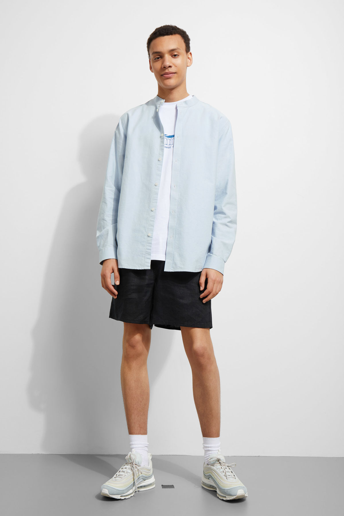 Model side image of Weekday haring collarless shirt in blue