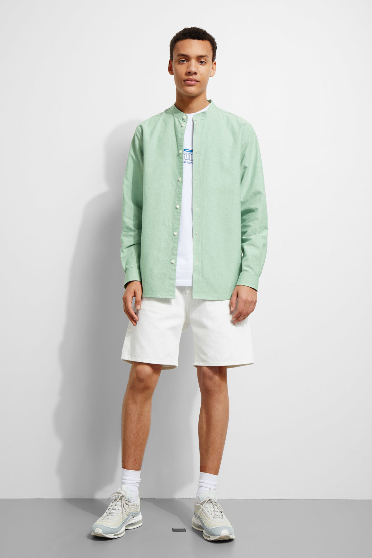 Model side image of Weekday haring collarless shirt in green