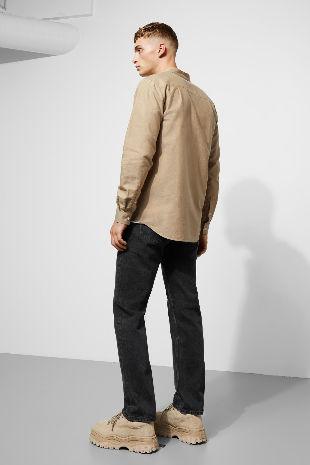 Model side image of Weekday haring collarless shirt in beige