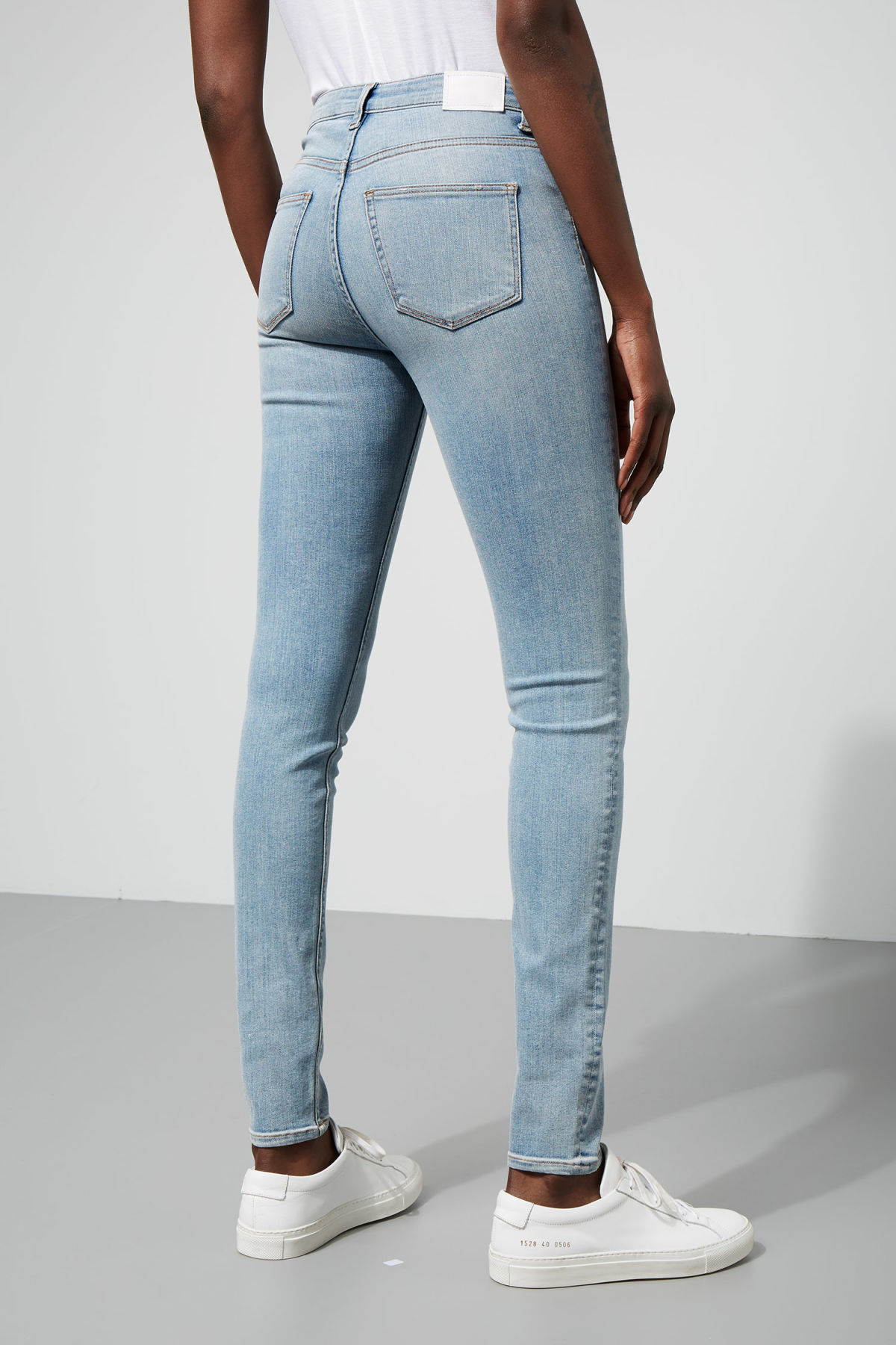 Model side image of Weekday body light jeans in blue