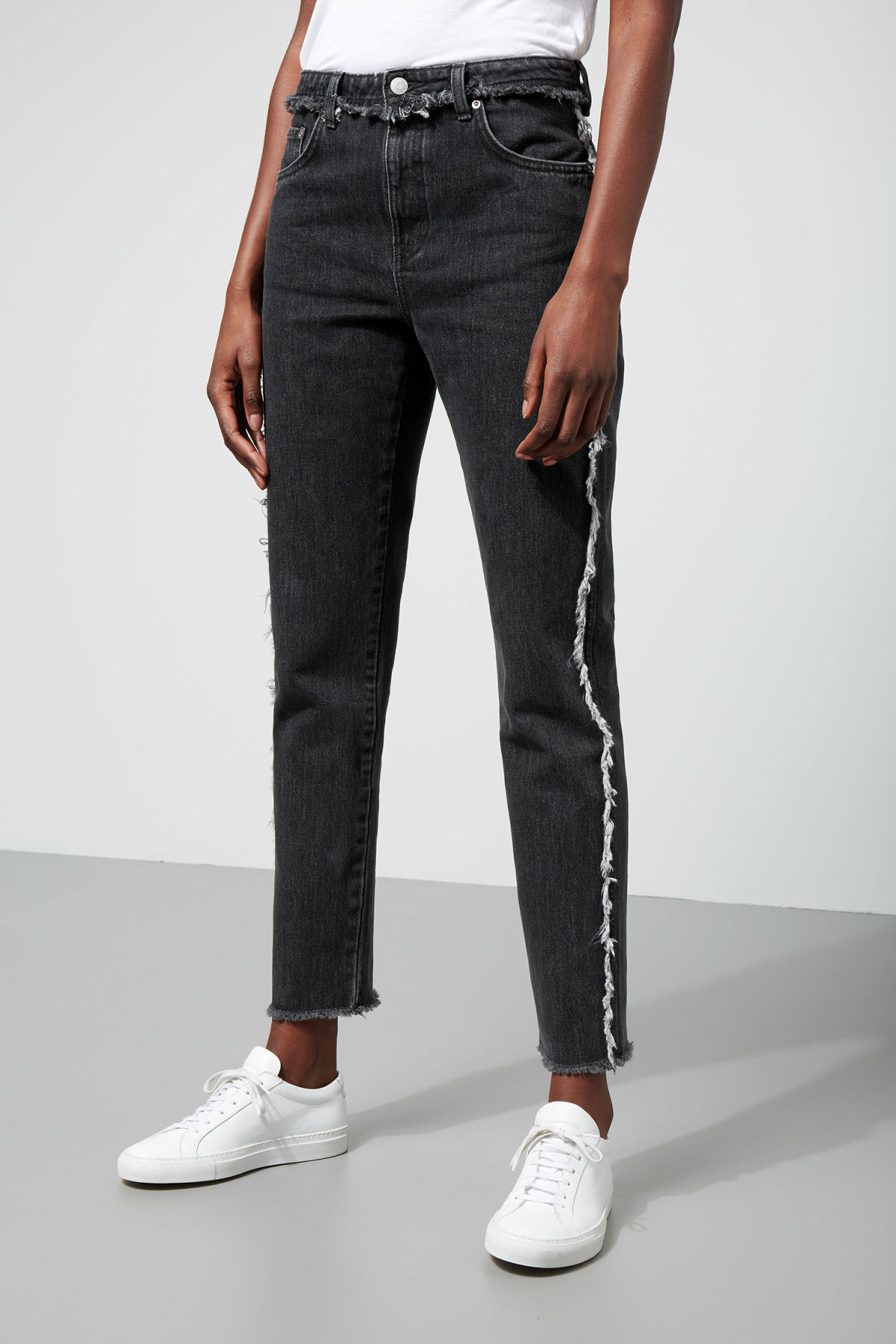 Model front image of Weekday seattle raw black jeans in black