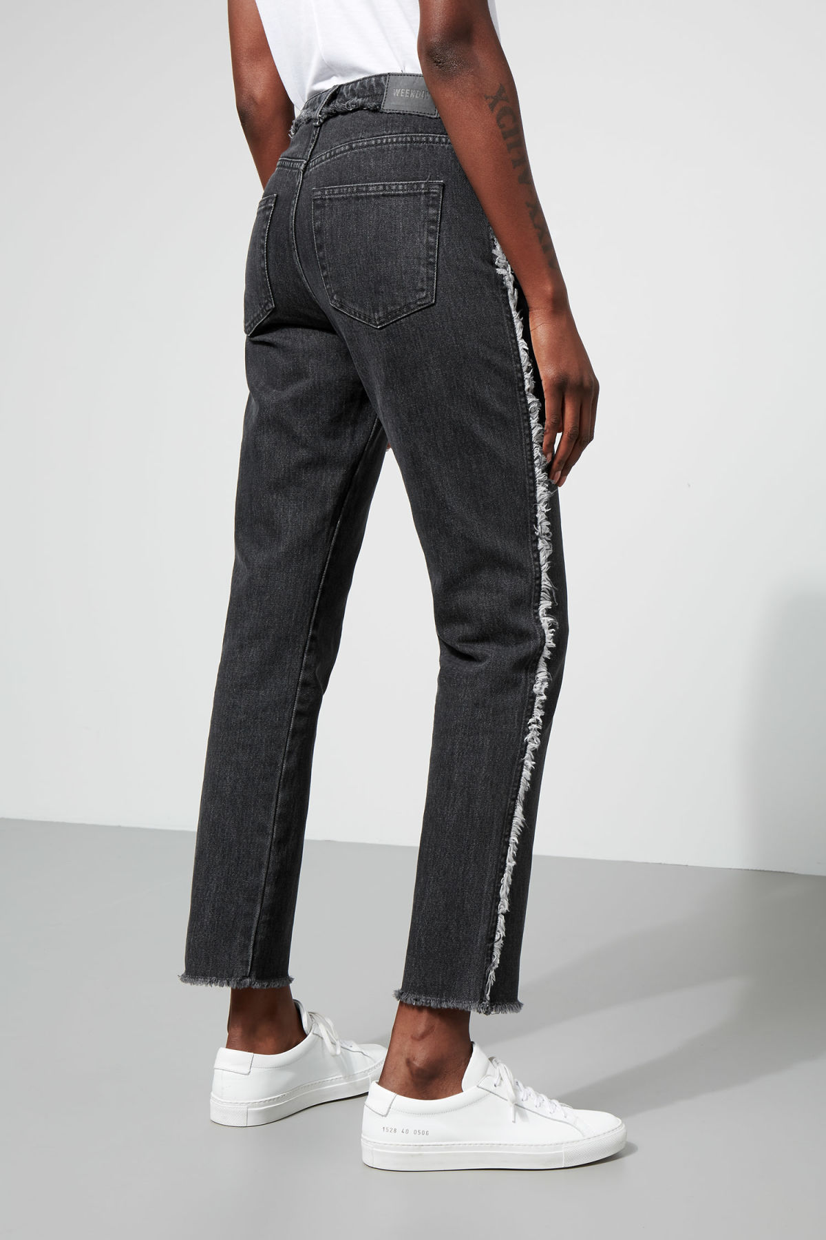 Model side image of Weekday seattle raw black jeans in black