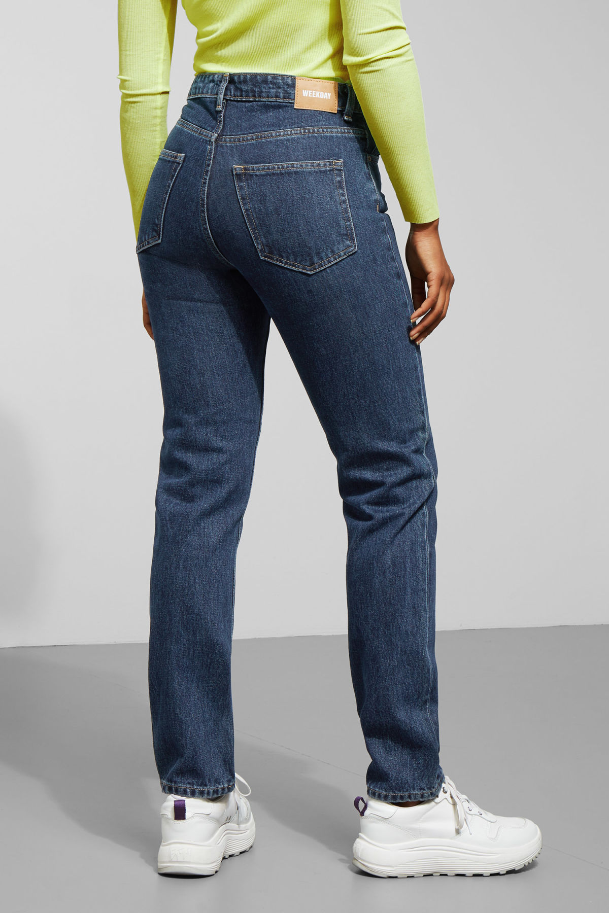 Model side image of Weekday seattle win jeans in blue