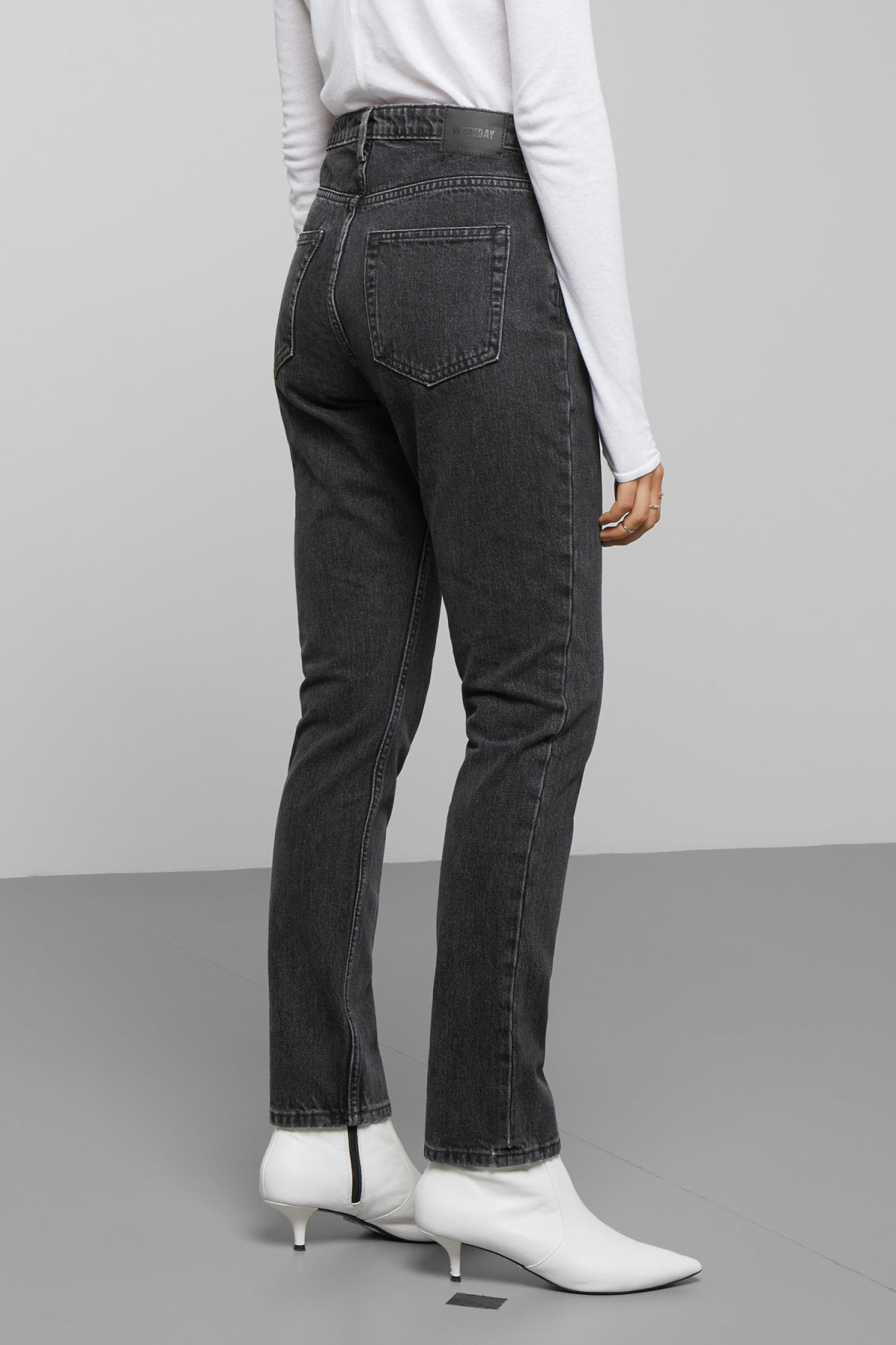 Model side image of Weekday seattle trotter black jeans in black